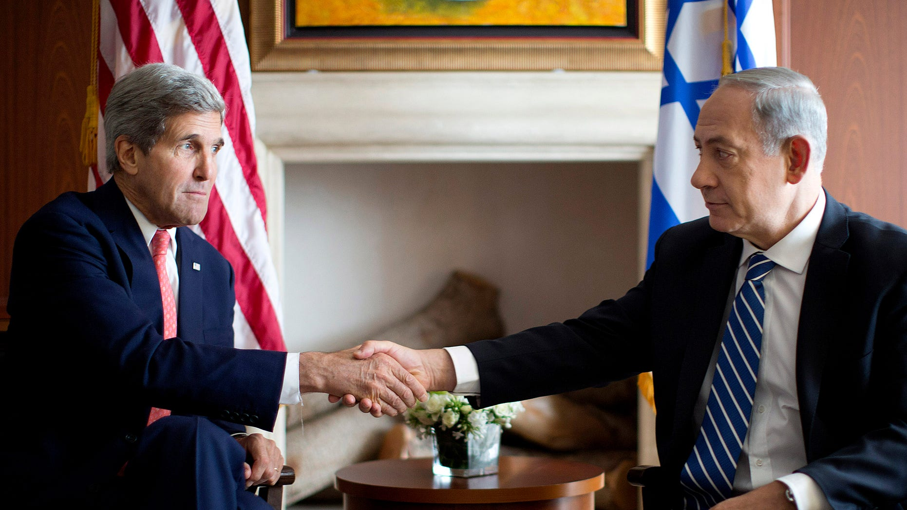 U.S. Secretary of State John Kerry, right, shakes hands with Israeli Prime Minister Benjamin Netanyahu in Jerusalem, Wednesday, Nov. 6, 2013. (AP Photo/Jason Reed, Pool)