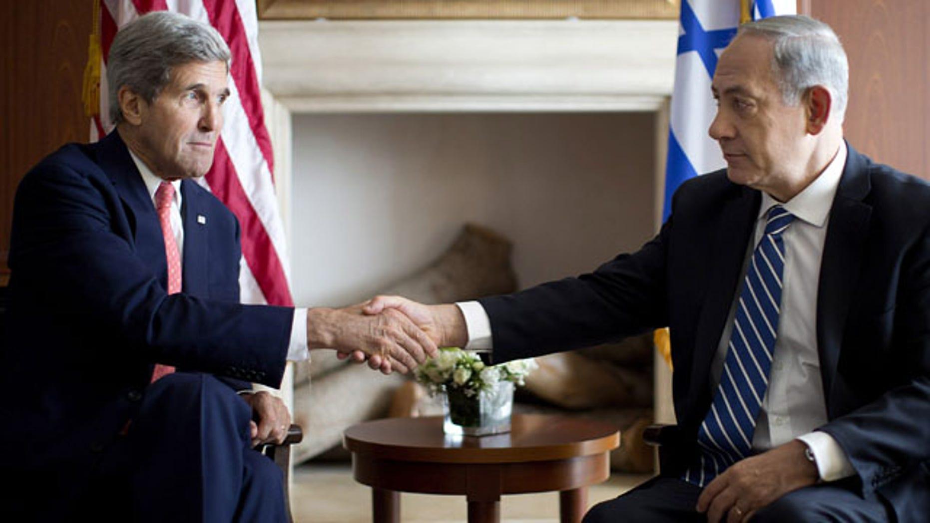 November 6, 2013: U.S. Secretary of State John Kerry, right, shakes hands with Israeli Prime Minister Benjamin Netanyahu in Jerusalem, Wednesday, Nov. 6, 2013. (AP Photo/Jason Reed, Pool)
