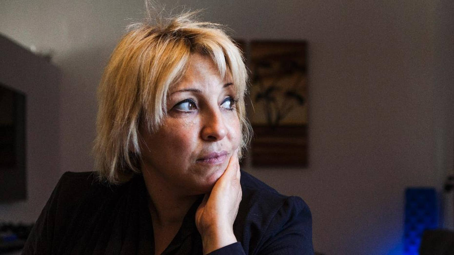 This photo taken on Tuesday, Dec. 30, 2014 shows Anett Haskia at her house at Kinbutz Yehiam next to the city of Nahariyah, Israel. Haskia is breaking every possible stereotype by running for a parliament seat with a pro-settler, religious Jewish party opposed to a Palestinian state. (AP Photo/Dan Balilty)