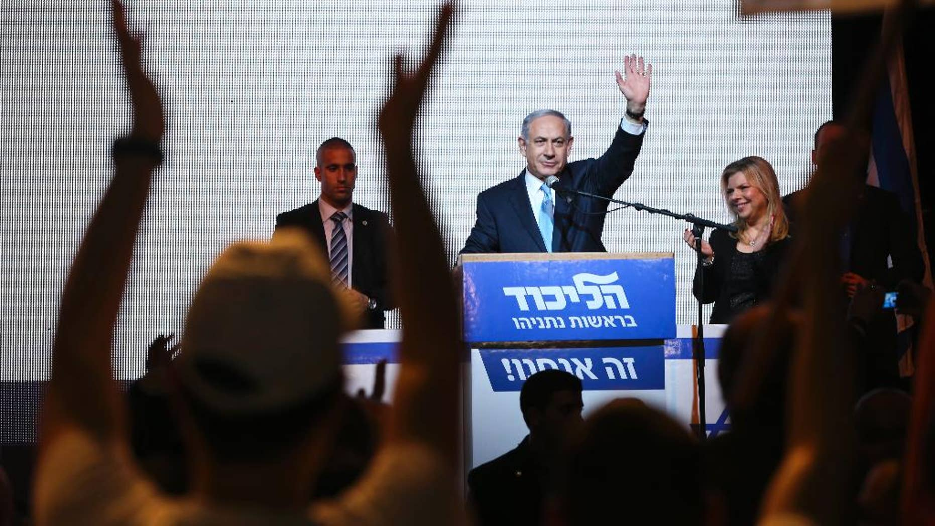 FILE - In this March 17, 2015 file photo, Israeli Prime Minister Benjamin Netanyahu greets supporters at the party's election headquarters in Tel Aviv, Israel. Netanyahu's Likud won 30 seats in the 120-seat parliament, and parties apparently willing to back him won another 37 for a possible majority. The reasons for that outcome go beyond the party's nationalist ideology and include Israel's sense of geographic vulnerability, its fragmented politics and a master campaigner in Netanyahu himself. (AP Photo/Oded Balilty, File)