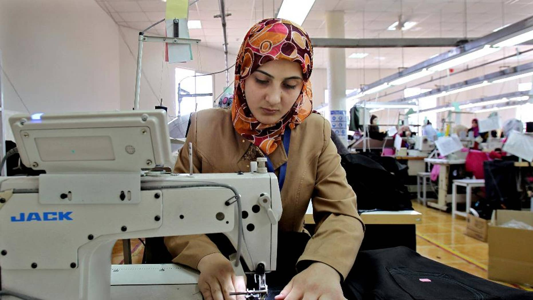 May 20, 2015: Jordanian women sew jeans for the U.S. market in a garment factory in the village of Kitteh in northern Jordan. The factory opened last year and created employment in an area where options had largely been limited to men joining the army and women staying home.