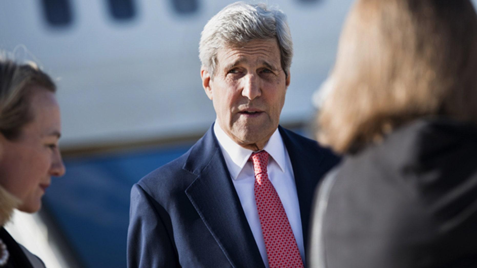 September 10, 2014: U.S. Secretary of State John Kerry arrives at Queen Alia Airport in Amman, Jordan. (AP Photo/Brendan Smialowski, Pool)