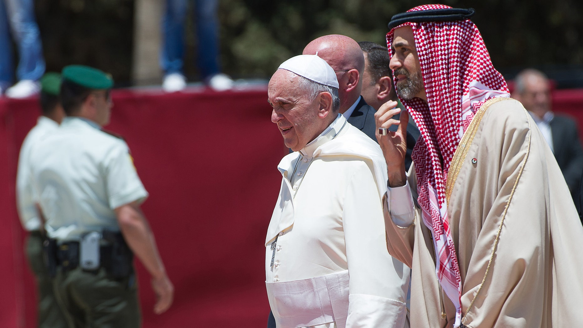 May 24, 2014: In this photo provided by the Vatican newspaper L'Osservatore Romano, Pope Francis is welcomed upon his arrival in Amman, Jordan.