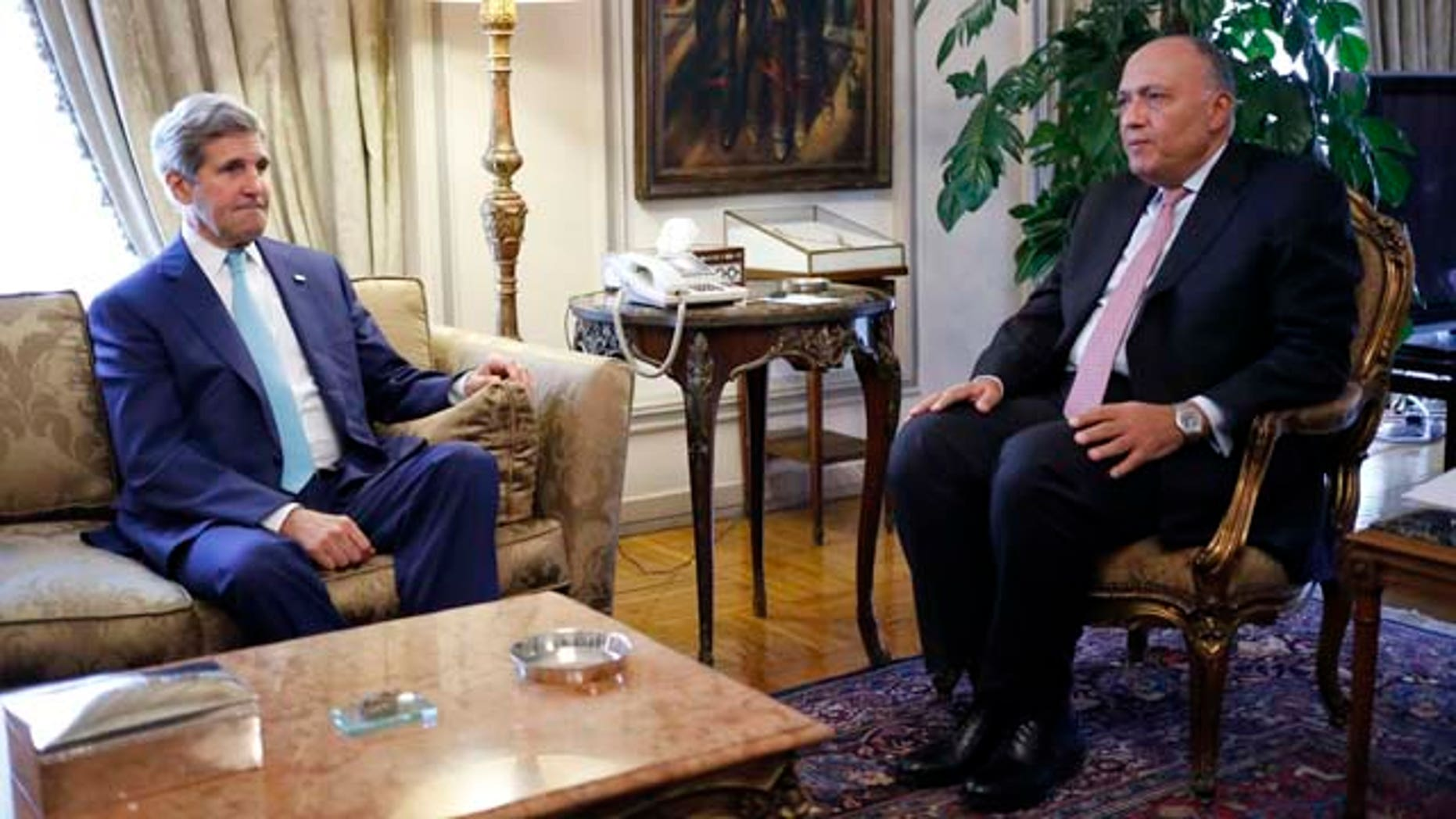 July 22, 2014: U.S. Secretary of State John Kerry meets with Egypt's Foreign Minister Sameh Shukri in Cairo.