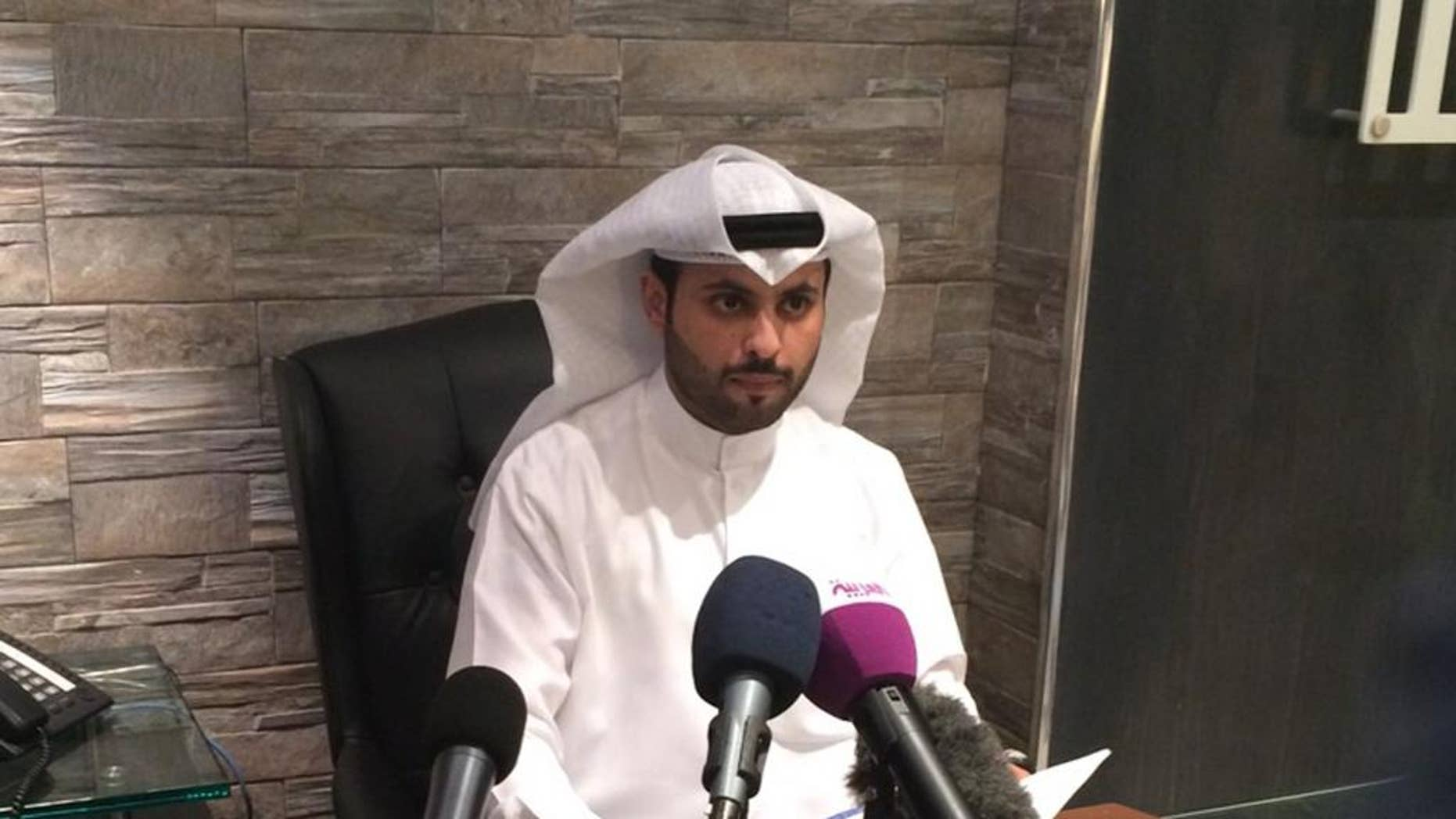 "Kuwaiti lawyer Salem al-Hashash talks to reporters in his office in Kuwait City on Sunday, March 8, 2015. The former lawyer for the father of Mohammed Emwazi, unmasked as ""Jihadi John"" last month, said there is no evidence proving the masked Islamic State militant is his client's son. (AP Photo/Hussain al-Qatari)"