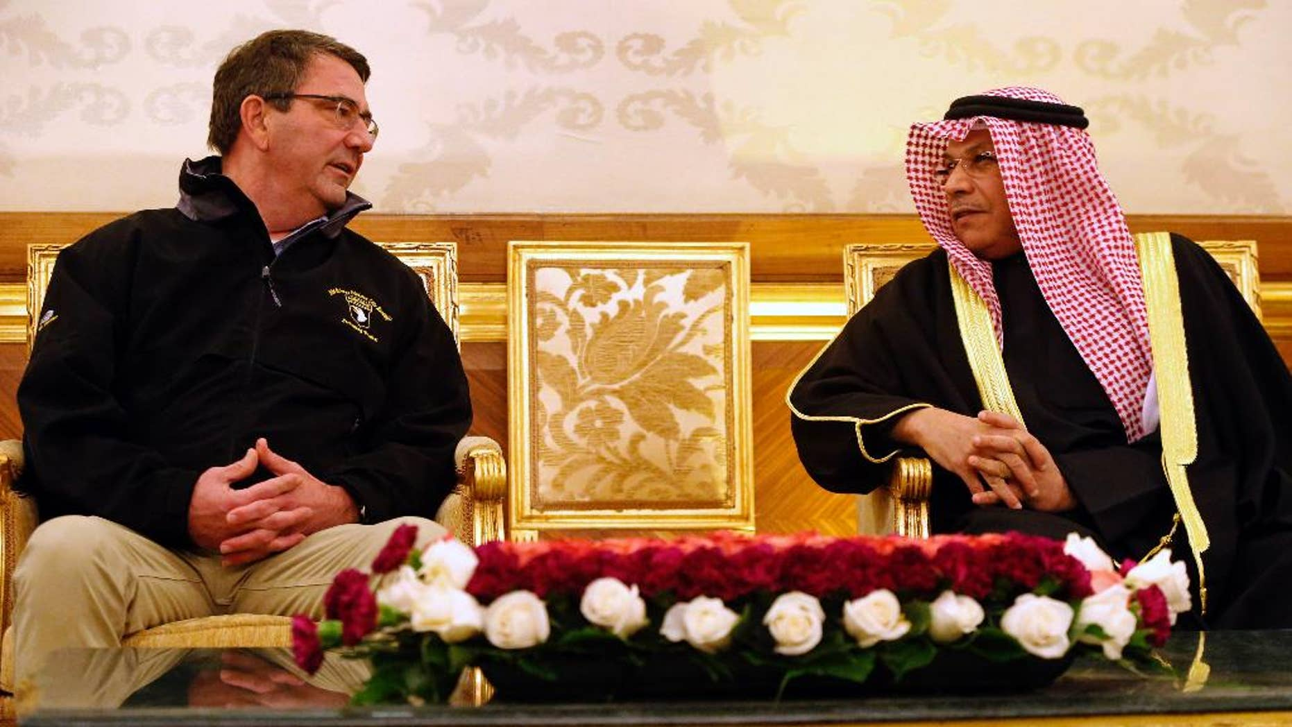 U.S. Defense Secretary Ash Carter, left, meets with Kuwait's Defense Minister Sheikh Khaled Al Jarrah Al Sabah, at Kuwait City International Airport, Kuwait, Sunday, Feb. 22, 2015.  Carter is on his first overseas trip since starting the Pentagon job last Tuesday. (AP Photo/Jonathan Ernst, Pool)