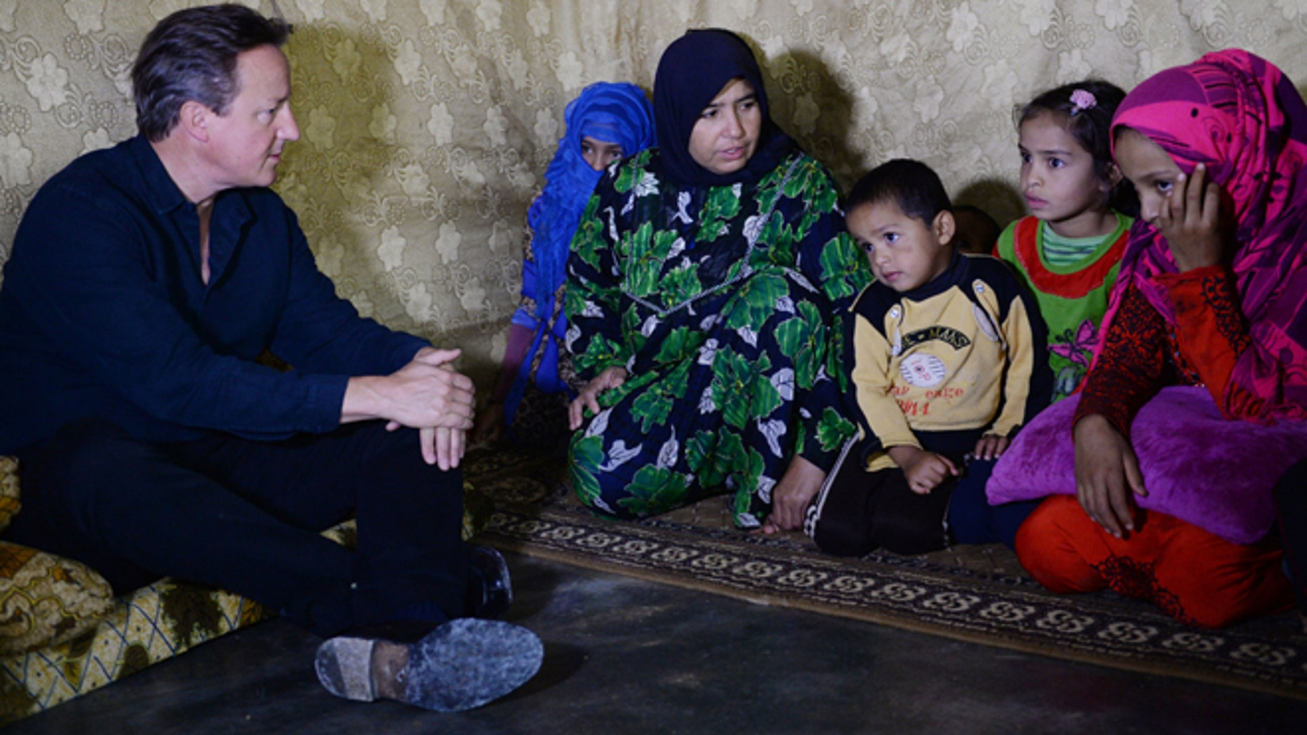 Sept. 14, 2015: Prime Minister David Cameron meets Syrian refugee families at a tented settlement camp on the Syrian - Lebanese border.