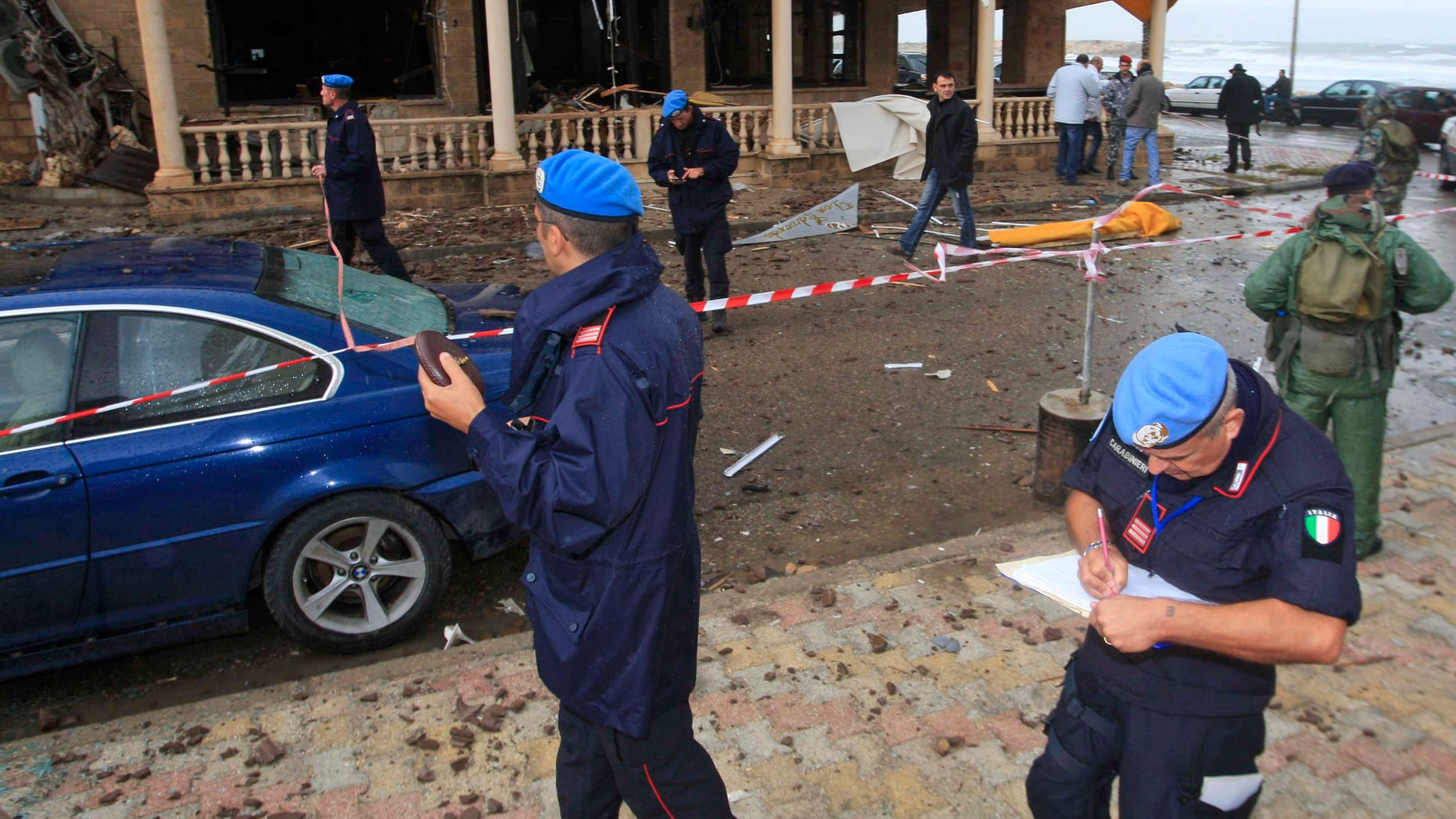 Nov. 16, 2011: U.N. peacekeeper investigators, inspect the scene where a bomb exploded in the pub of the Queen Elissa Hotel, in the southern port city of Tyre.