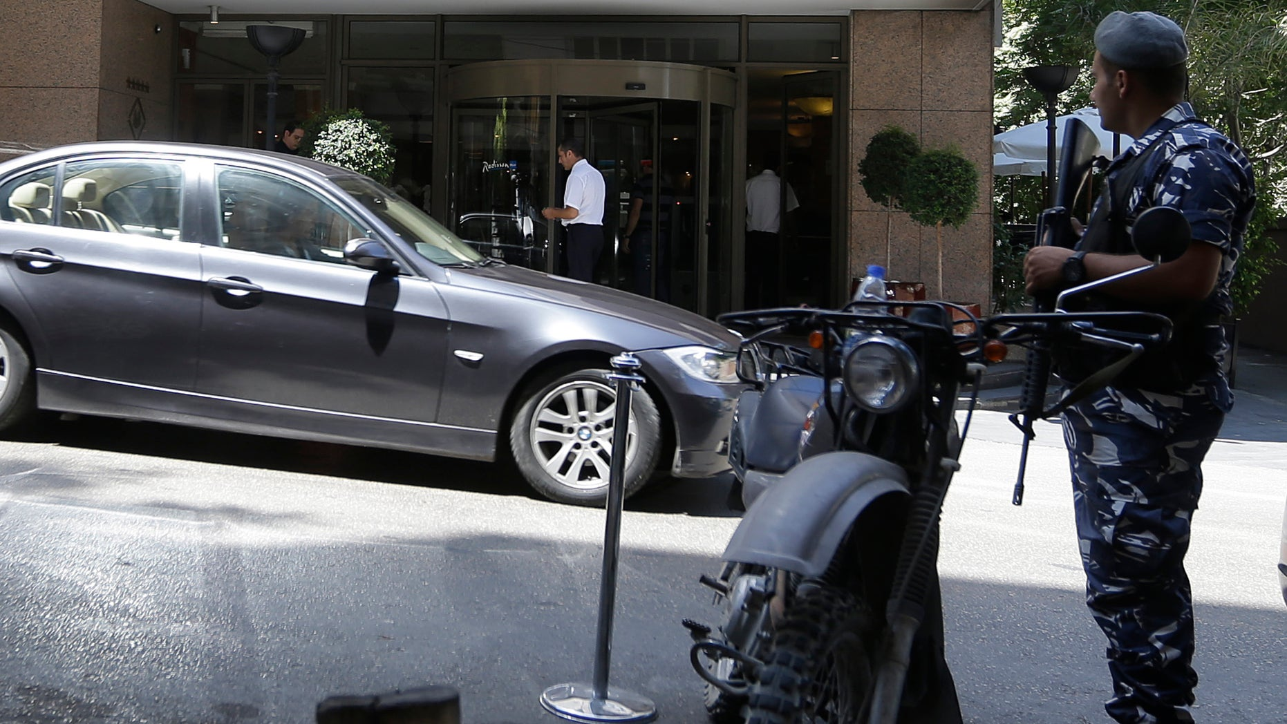 Aug. 9, 2013 - A Lebanese policeman stands guard in front of a hotel where the rest of the Turkish Airlines crew stay after six gunmen ambushed their vehicle on an old airport road and snatched two men of the Turkish crew, according to Lebanese officials, in Beirut, Lebanon.