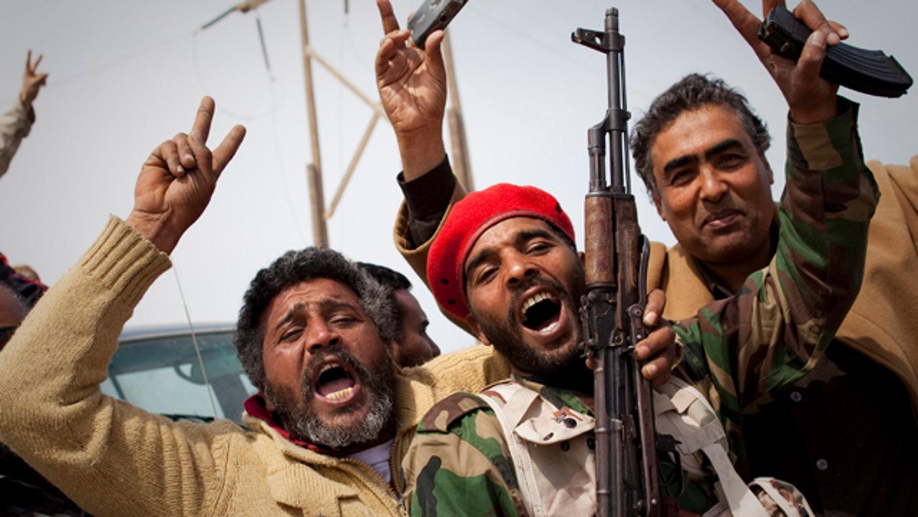 March 27, 2011: Libyan rebels jubilate on a checkpoint in Al-Egila, east of Ras Lanuf, eastern Libya.