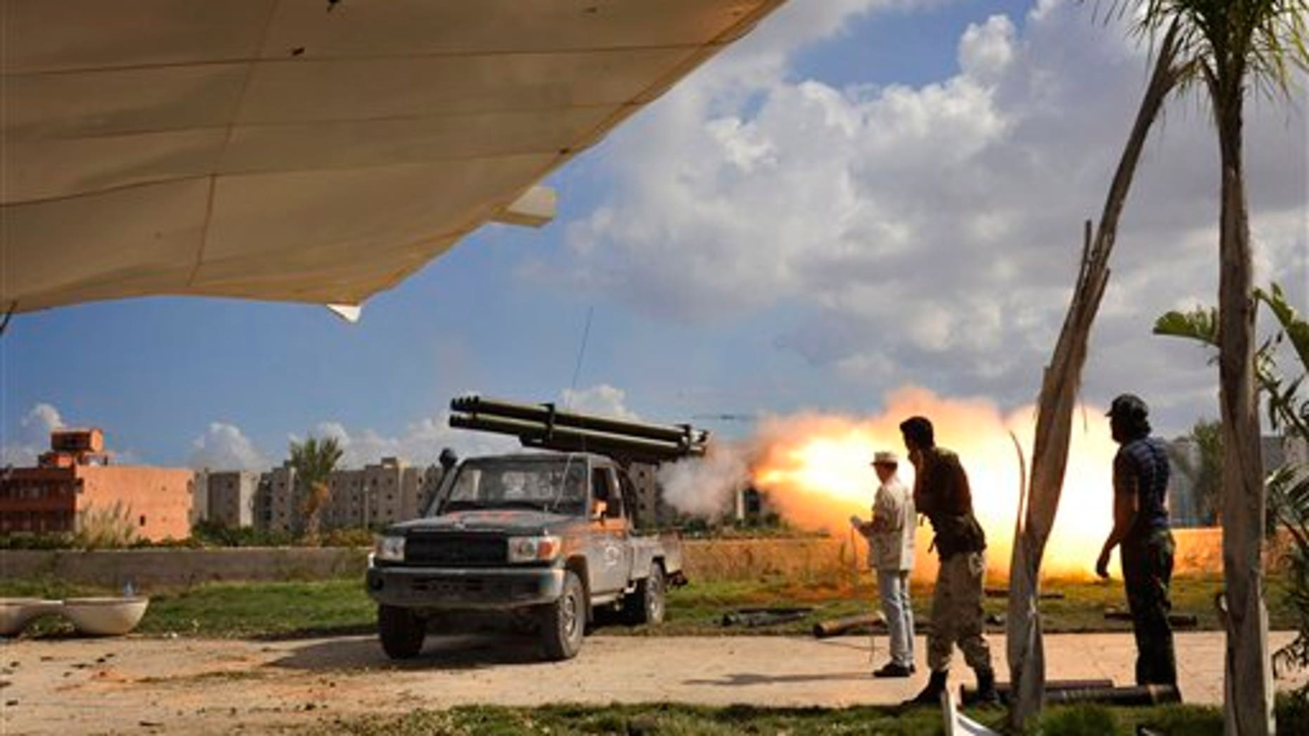 October 14: Libyan revolutionary fighters launch a missile towards pro-Gadhafi forces in downtown Sirte, Libya.