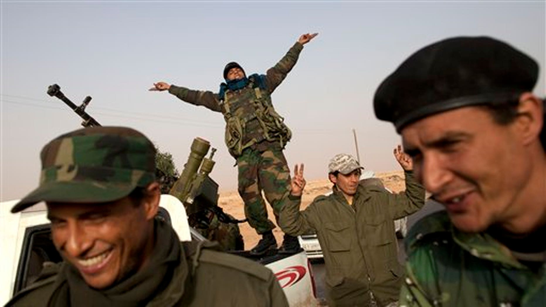 March 5: Libyan rebels who are part of the forces against Libyan leader Muammar Qaddafi celebrate their victory in fighting against troops loyal to Qaddafi, in the oil town of Ras Lanuf, eastern Libya (AP).