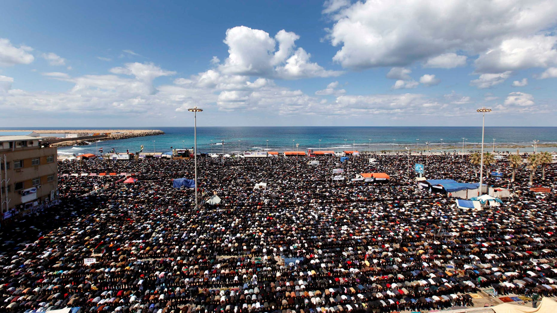 March 11: Anti-Libyan Leader Muammar Qaddafi protesters pray during the Friday prayer at the court square, in Benghazi, eastern Libya. (AP)