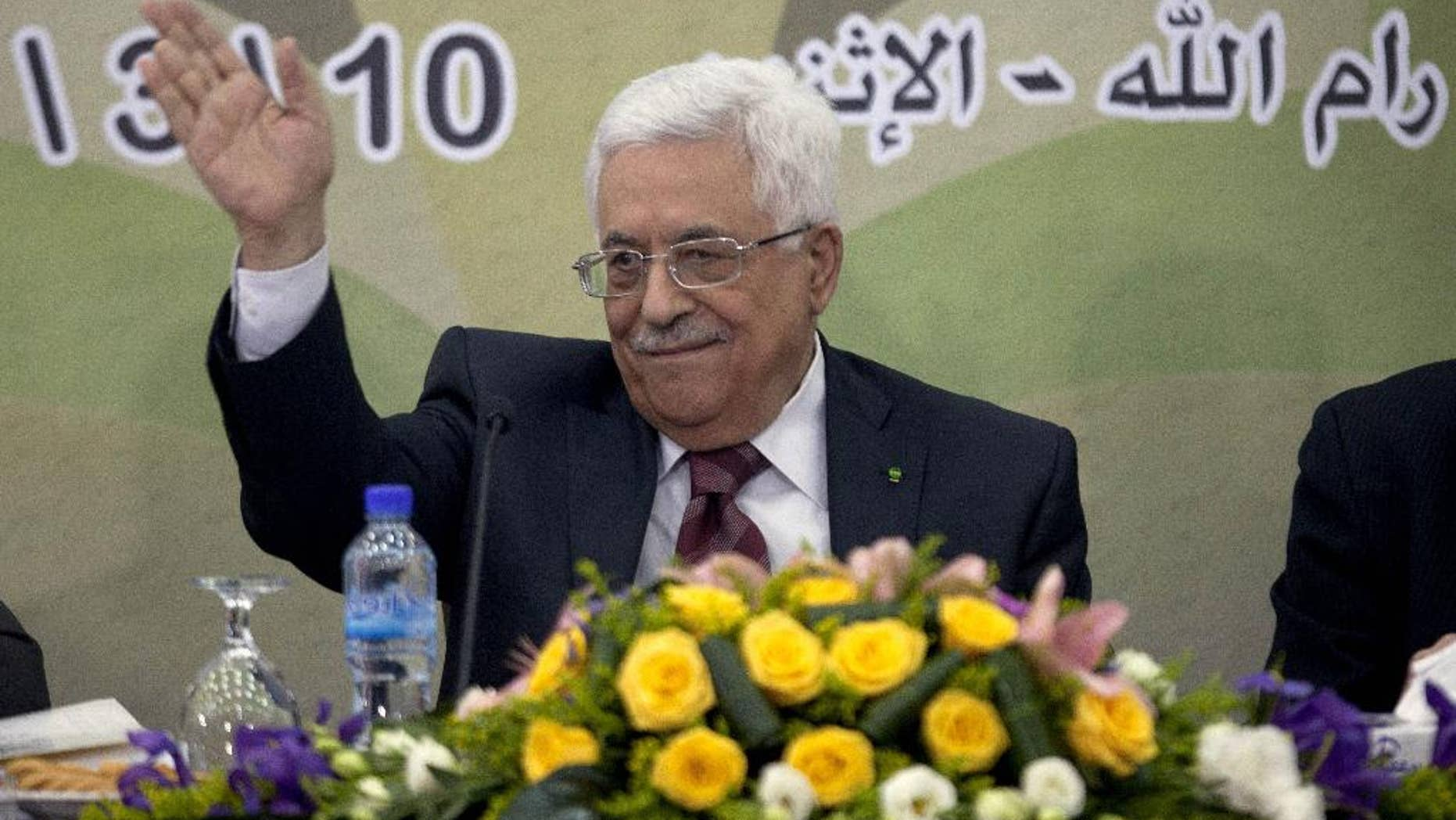 In this March 10, 2014 file photo, Palestinian President Mahmoud Abbas gestures during a meeting of the Fatah revolutionary council in the West Bank city of Ramallah. A long-running personal feud between Palestinian President Mahmoud Abbas and a former powerful operative in his Fatah movement has erupted into the open with public accusations of deceit and corruption. Abbas' hour-long tirade against the exiled Mohammed Dahlan signals the battle is heating up over who will one day succeed the 79-year-old president. (AP Photo/Majdi Mohammed, File)