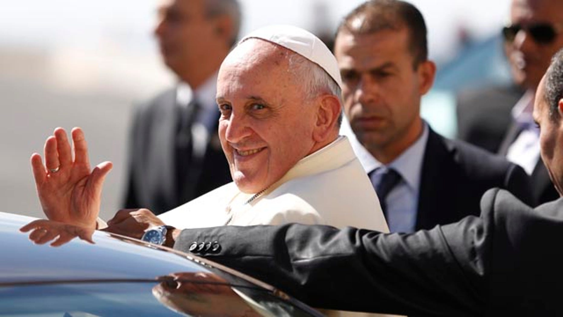 May 25, 2014: Pope Francis waves upon his arrival at the West Bank town of Bethlehem on Sunday, May 25, 2014. (AP Photo/Mohamad Torokman, Pool)