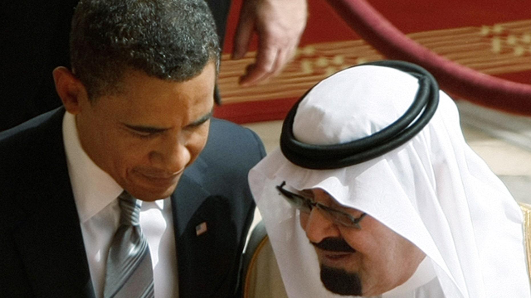 FILE - In this Wednesday, June 3, 2009 file photo, King Abdullah of Saudi Arabia, right, speaks with U.S. President Barack Obama, during arrival ceremonies at the Royal Terminal of King Khalid International Airport in Riyadh, Saudi Arabia. (AP Photo/Hassan Ammar)