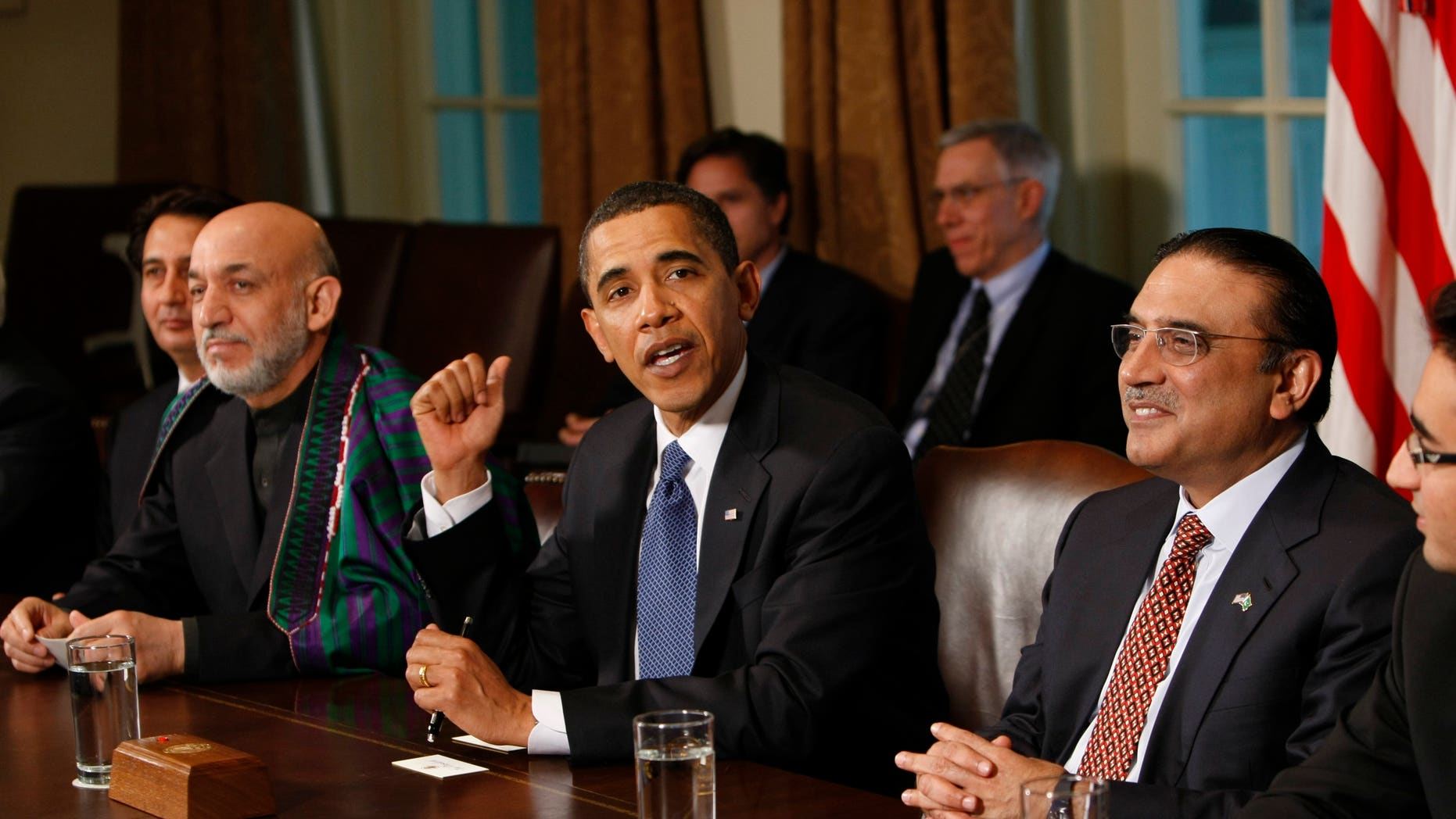 In this Wednesday, May 6, 2009 file photo, U.S. President Barack Obama, center, flanked by Afghan President Hamid Karzai, left, and Pakistani President Asif Ali Zardari gestures in the Cabinet Room of the White House in Washington. The United States has been pushing its powerhouse ally Saudi Arabia to help stabilize Pakistan and Afghanistan, but it has struggled to overcome the kingdom's deep mistrust of Pakistan's president and doubts over U.S. strategy for reining in militants, leaked U.S. diplomatic memos show.