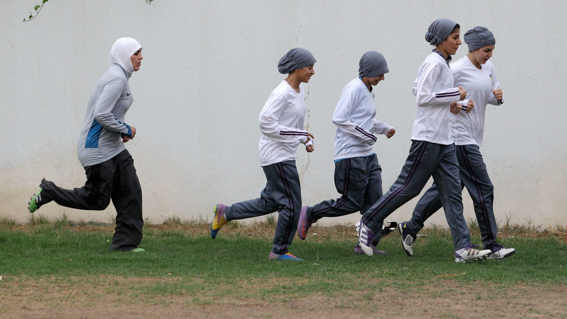 In this May 21, 2012 file photo, members of a Saudi female soccer team practice at a secret location in Riyadh, Saudi Arabia.