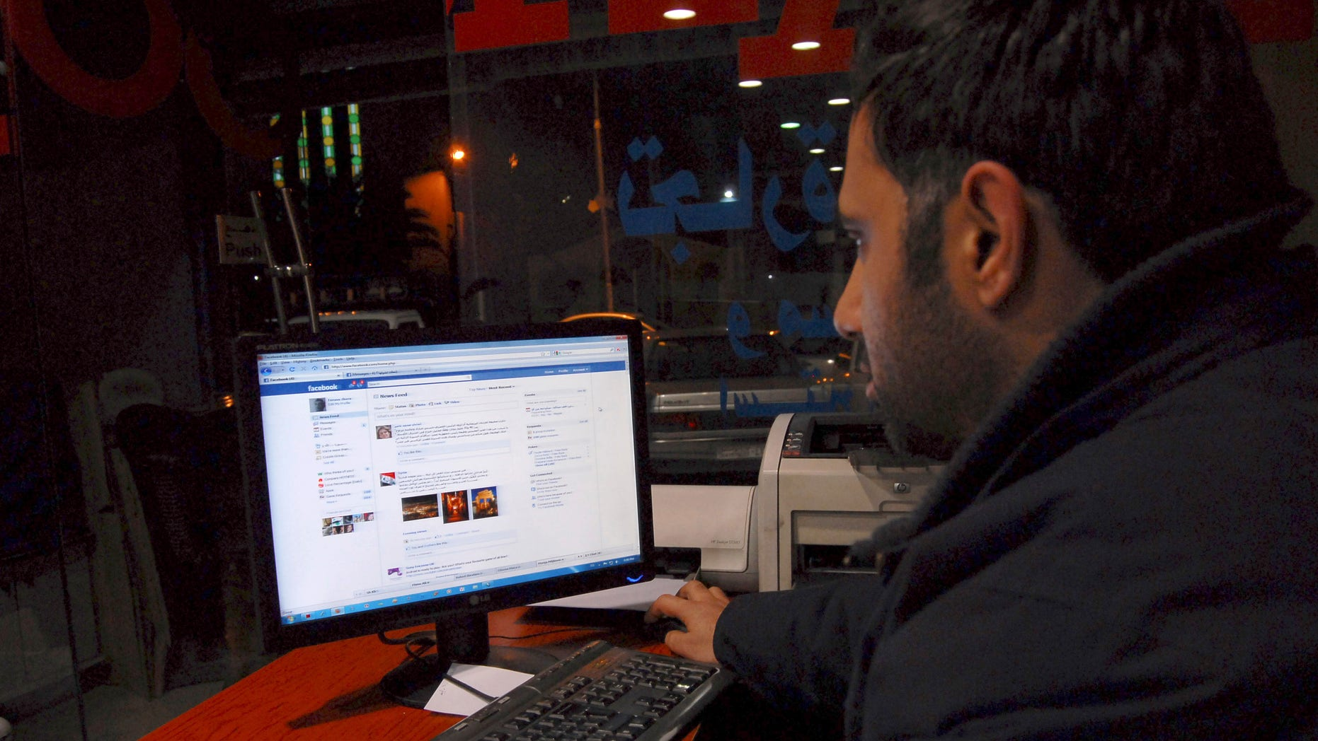 Feb. 8: A Syrian man connects on his Facebook account at an internet cafe, in Damascus, Syria. A media watchdog said Tuesday that Syria appears to be lifting a three-year-old ban on YouTube and Facebook, a decision that could be seen as a gesture to stave off unrest following popular uprisings in Egypt and Tunisia. (AP)