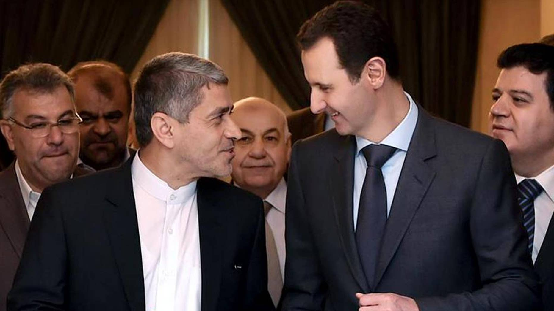 "This photo released on the official Facebook page of the Syrian Presidency, shows Syrian President Bashar Assad, right, meeting with Iranian minister of economy and financial affairs, Ali Tayebnia, left, in Damascus, Syria, Monday, March 16, 2015. Assad said to Iranian TV ""only the Syrian people can decide his future adding that Damascus is not concerned about statements made abroad."" (AP Photo)"
