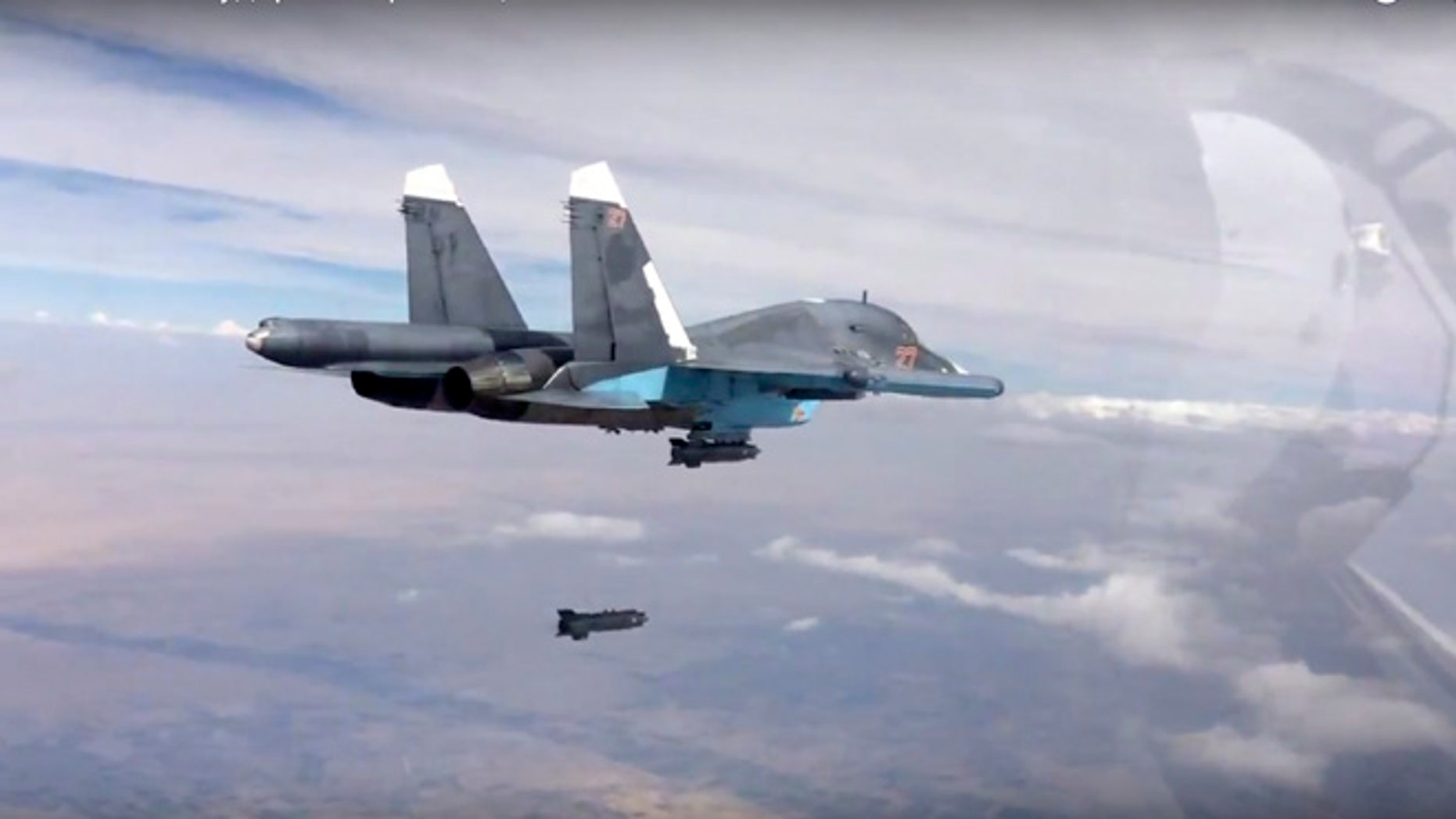 Oct. 9, 2015: A bomb is released from Russian Su-34 strike fighter in Syria.