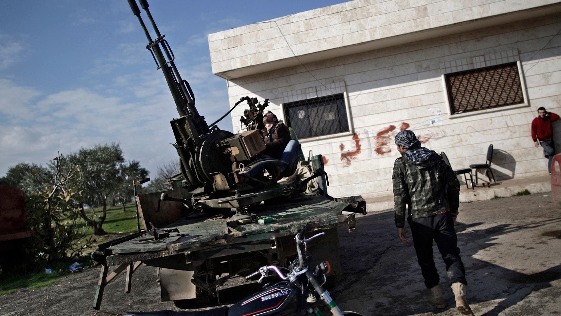 Dec. 14, 2012 - Syrian rebel checks an anti-aircraft weapon, in Maaret Misreen, near Idlib, Syria.