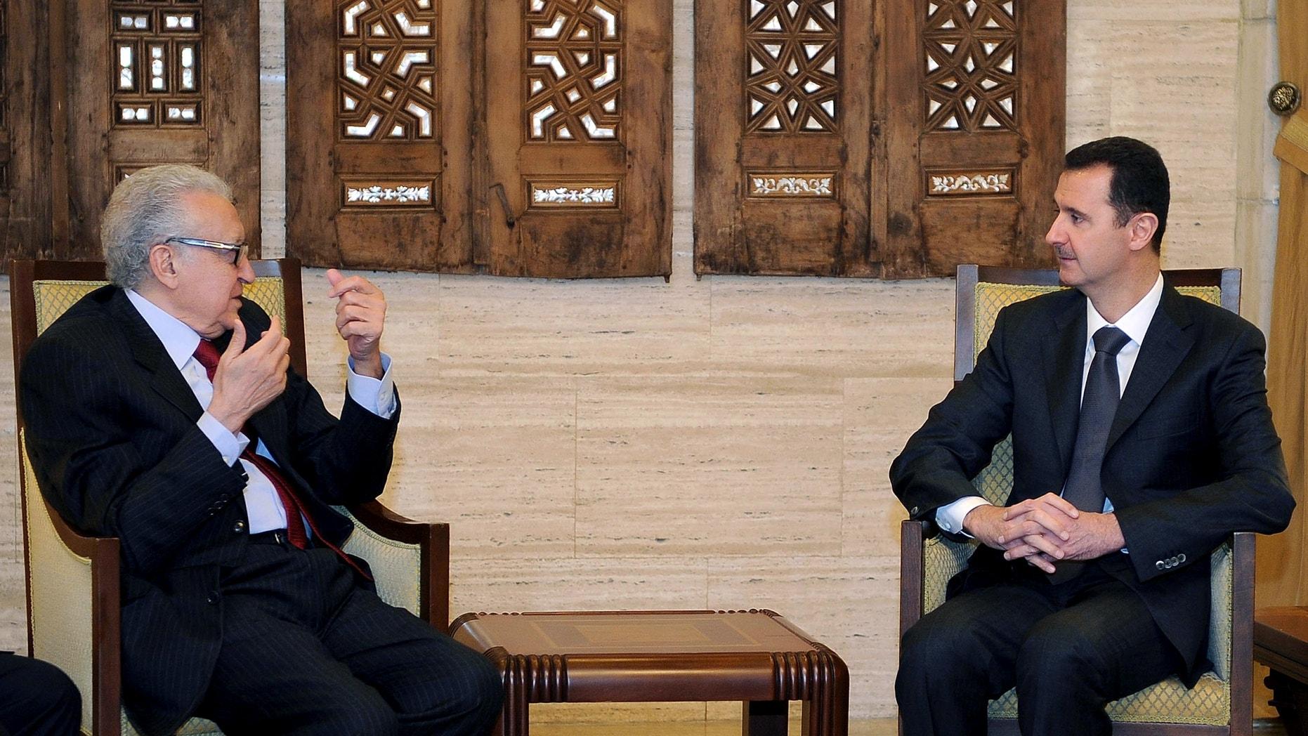 Dec. 24, 2012 - Syrian President Bashar al-Assad, right, meets with UN Arab League deputy to Syria, Lakhdar Brahimi in Damascus, Syria.