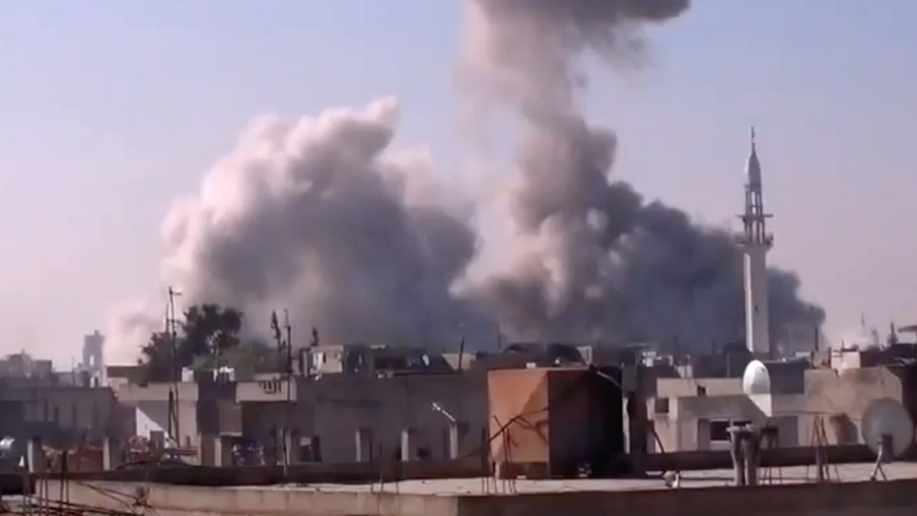 Dec. 27, 2012 - In this image taken from video obtained from the Shaam News Network, smoke rises from buildings from heavy shelling in Homs, Syria.