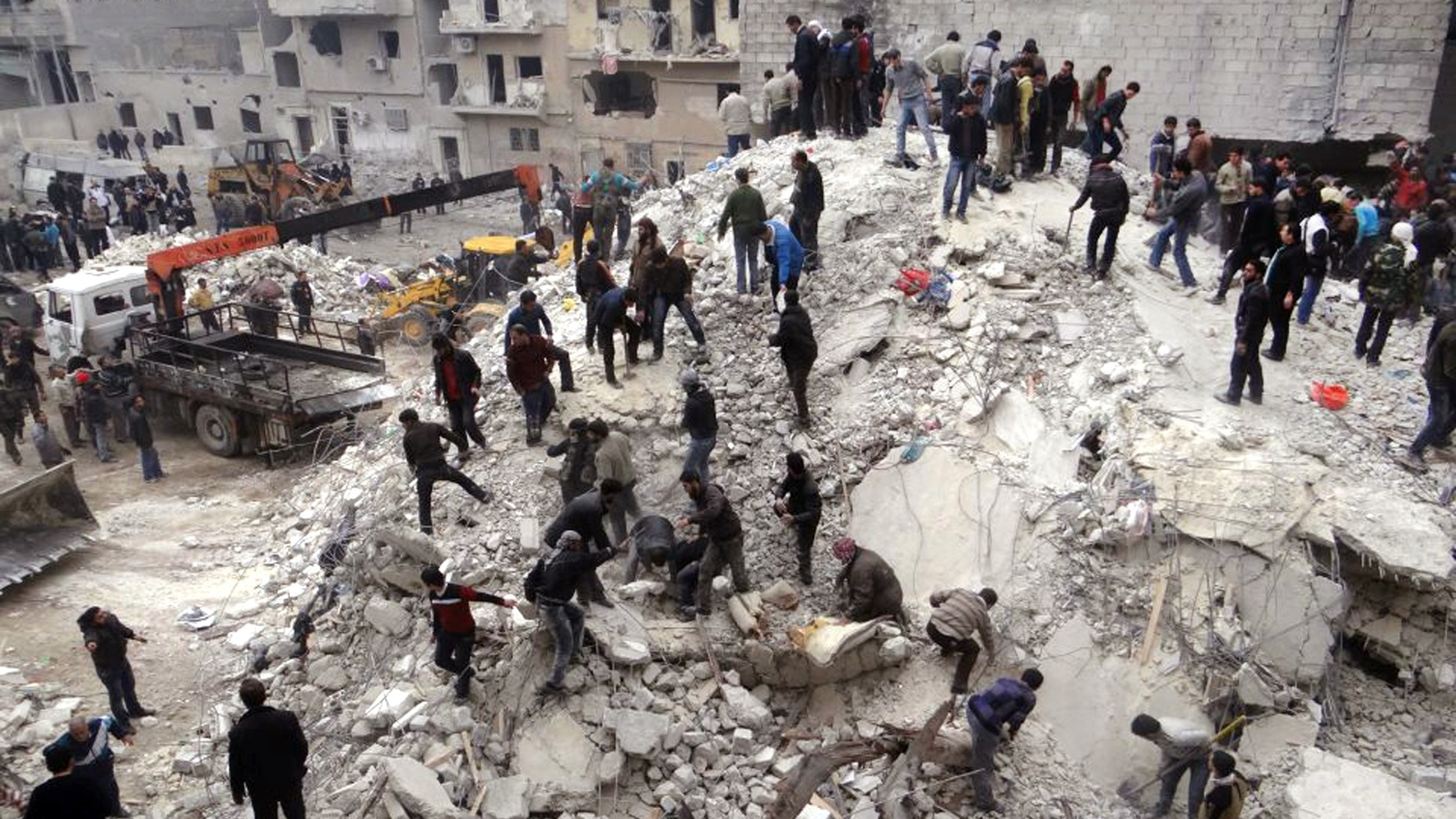 Feb. 3, 2013 - This citizen journalism image provided by Aleppo Media Center, shows people searching through the debris of destroyed buildings after airstrikes hit the neighborhood of Eastern Ansari, in Aleppo, Syria.