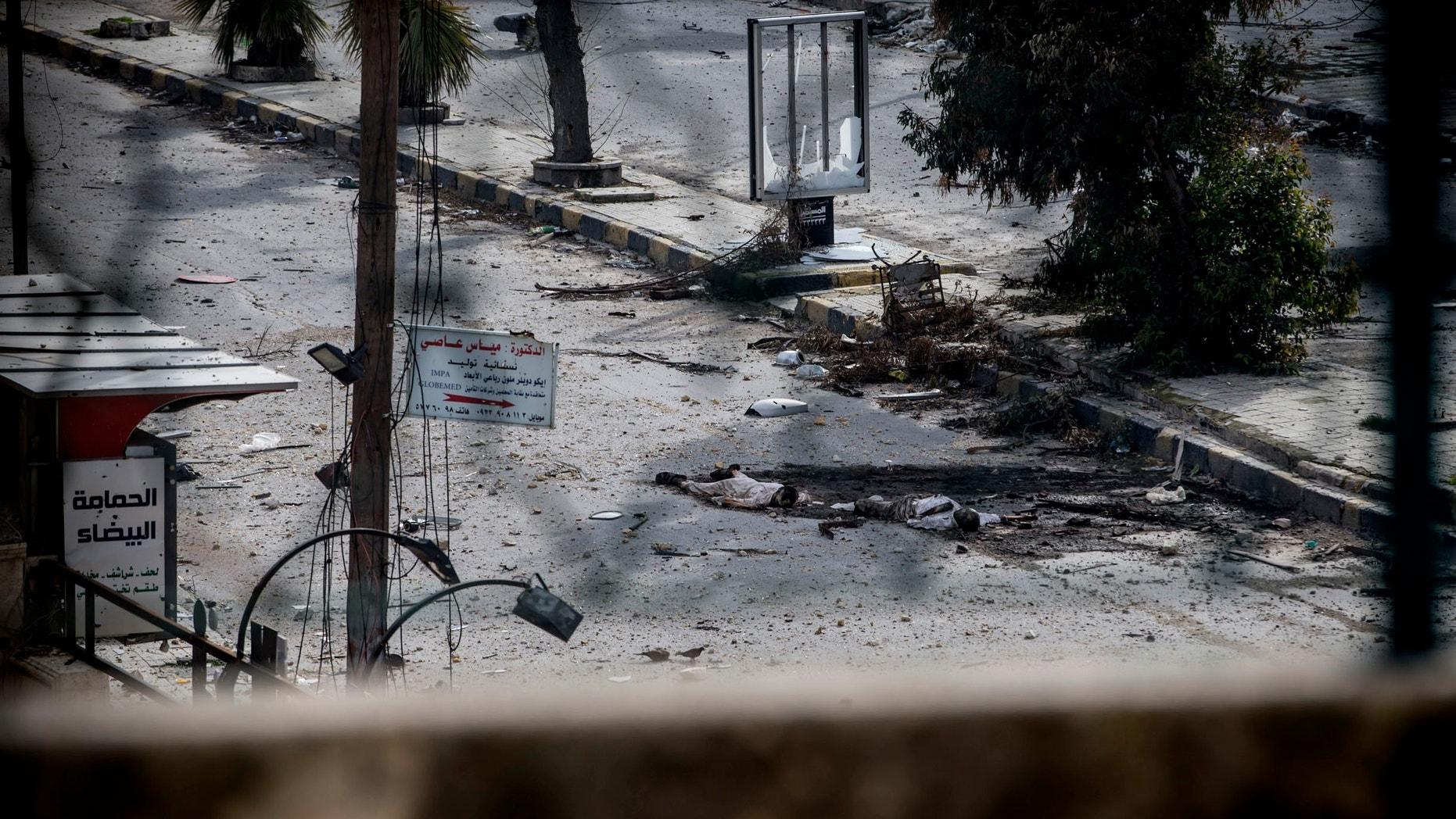 Jan. 13, 2013 - Two dead bodies lie on a street in the Saif al-Dawlah neighborhood of Aleppo, Syria.