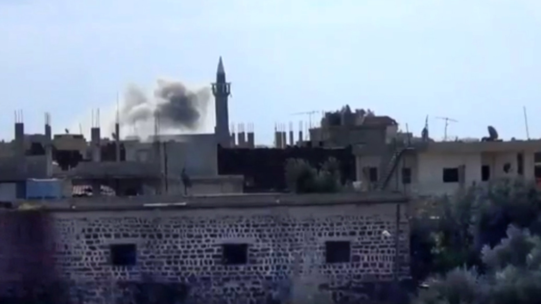 Jan. 24, 2013 - Image taken from video from the Shaam News Network: smoke rises from buildings due to heavy shelling in Daraa, Syria.
