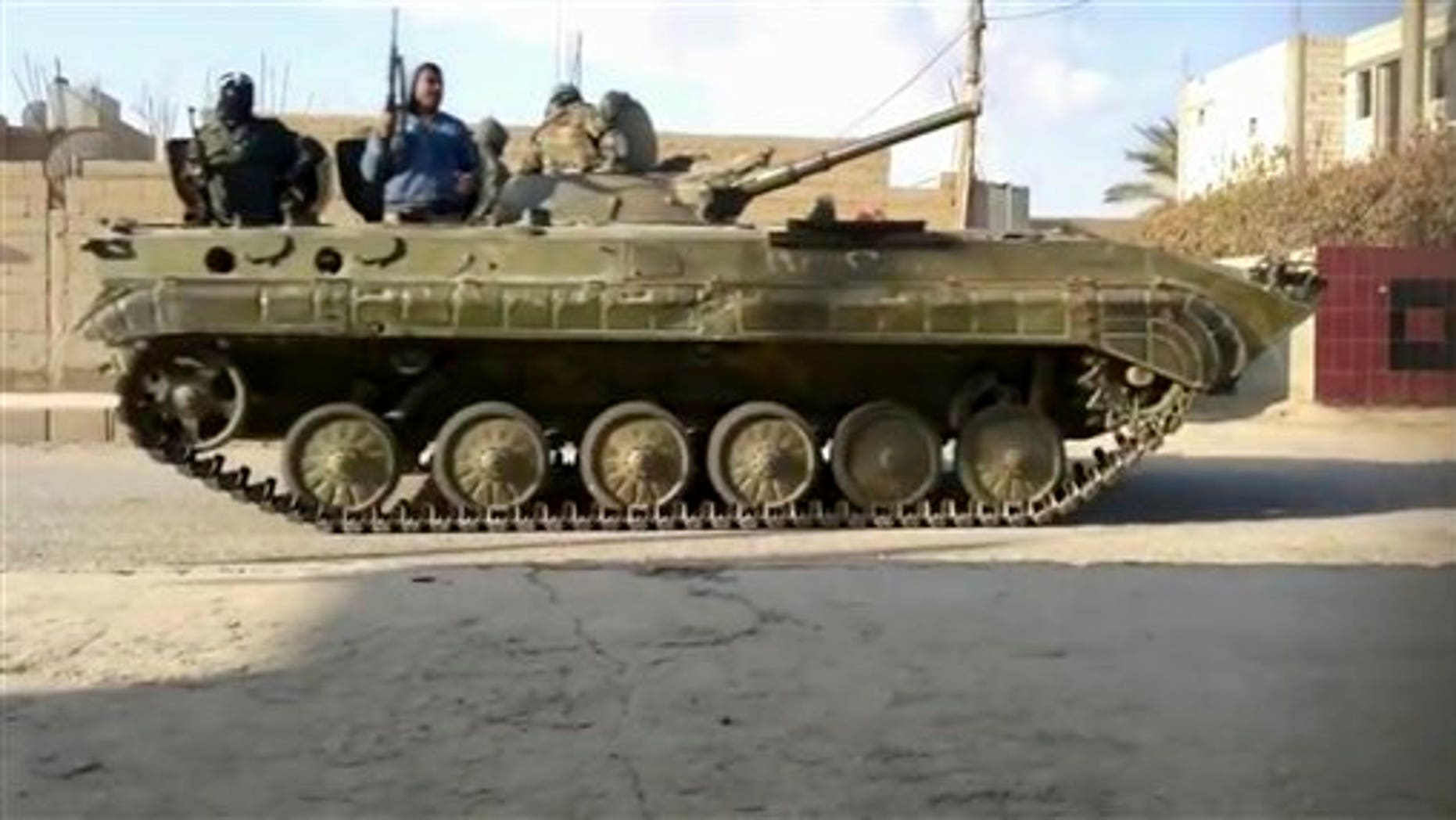 January 17, 2012: This image from amateur video made available by Shaam News Network purports to show a tank in Deir al-Zour, Syria.