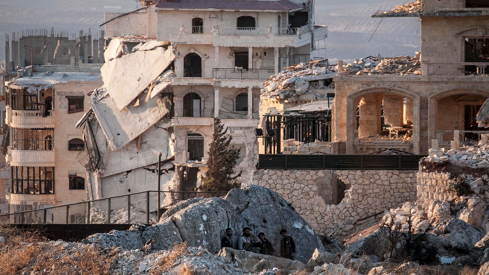 Syrian opposition fighters take cover in Telata village, in northwestern Syria, Sunday, Sept. 29, 2013.