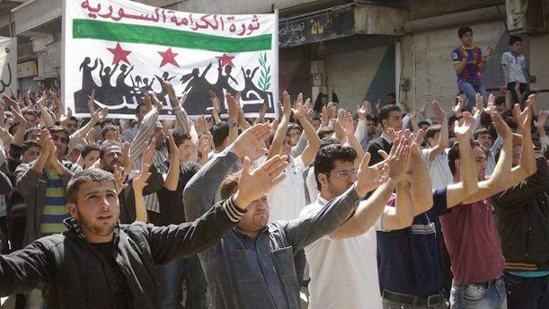 April 6, 2012: In this citizen journalism image provided by the Local Coordination Committees in Syria, Syrians chant slogans during a demonstration in Idlib, north Syria.