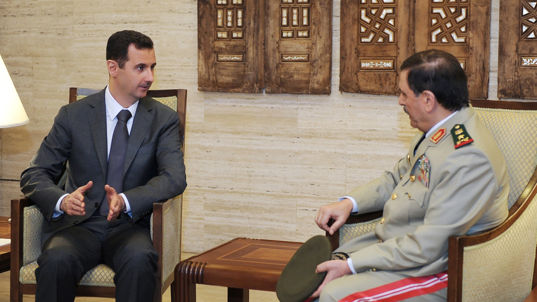July 19, 2012: In this photo released by the Syrian official news agency SANA, Syrian President Bashar Assad, left, meets with Fahd Jassem al-Freij, Syria's new Defense Minister, in Damascus, Syria.