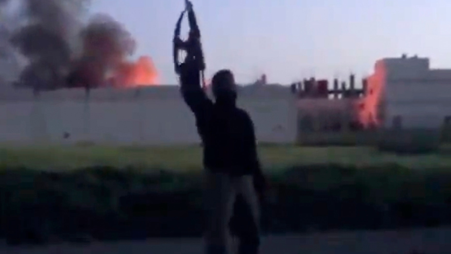 March 28, 2013 - Image taken from video shows a building at the Syrian government checkpoint on fire, in Dael less than 10 miles from the Jordanian border in Daraa province, Syria.