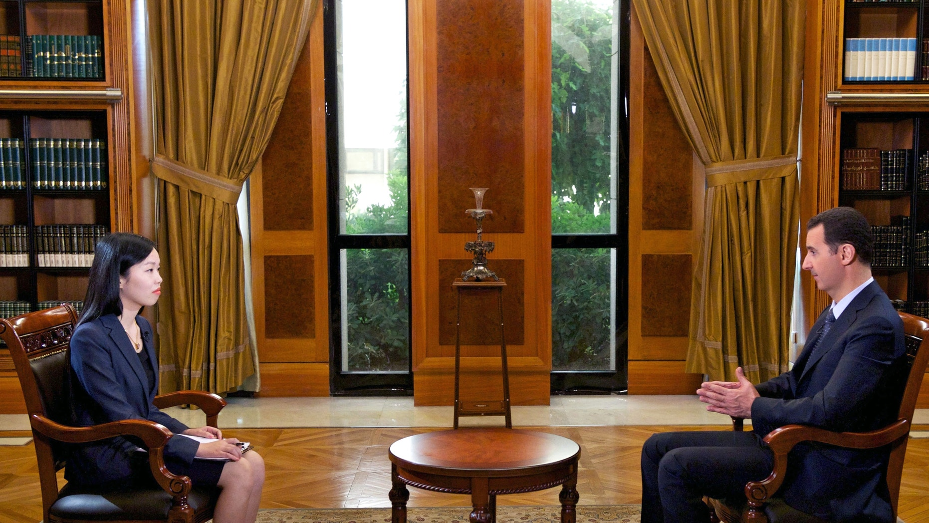 Sept. 23, 2013 - Syrian President Bashar Assad speaks during an interview with Chinese state CCTV, in Damascus, Syria.  Assad said his government will allow international experts access to its chemical weapons sites but cautioned that rebels might block them from reaching some of the locations.