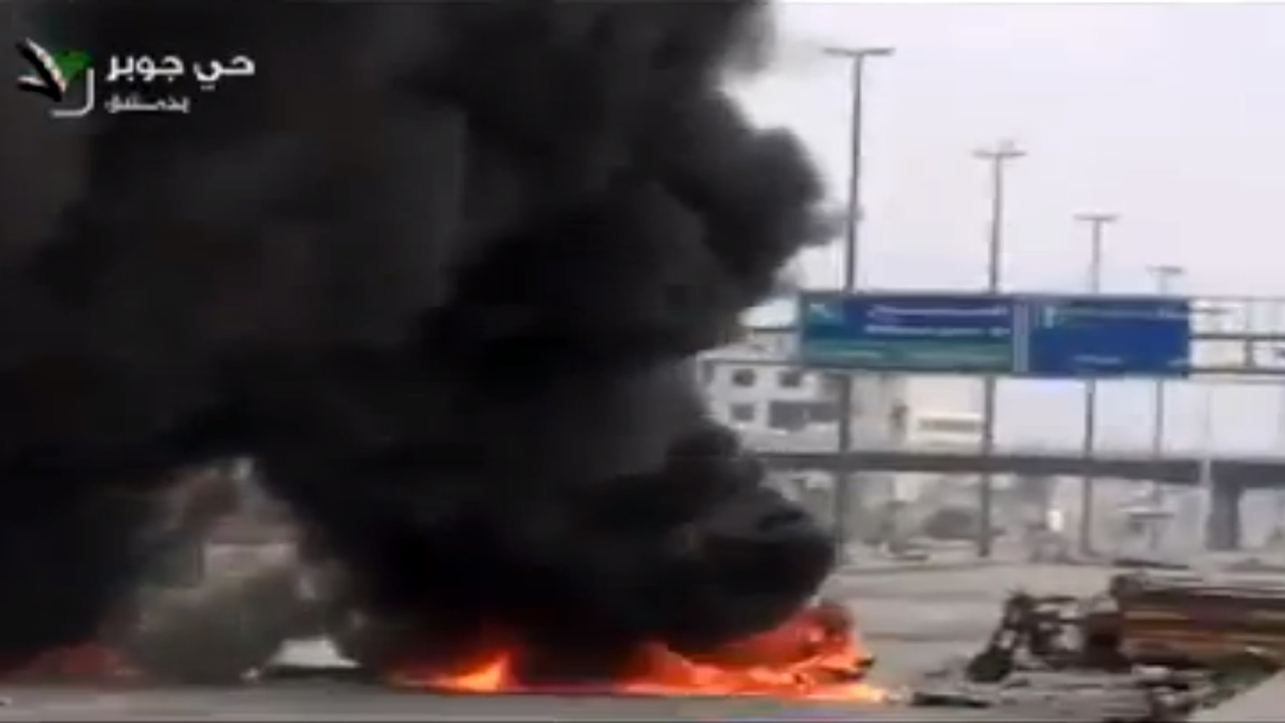 Feb. 8, 2013 - Image taken from video obtained from Ugarit News on Friday, shows smoke and fire rising on a main highway in Damascus, Syria.