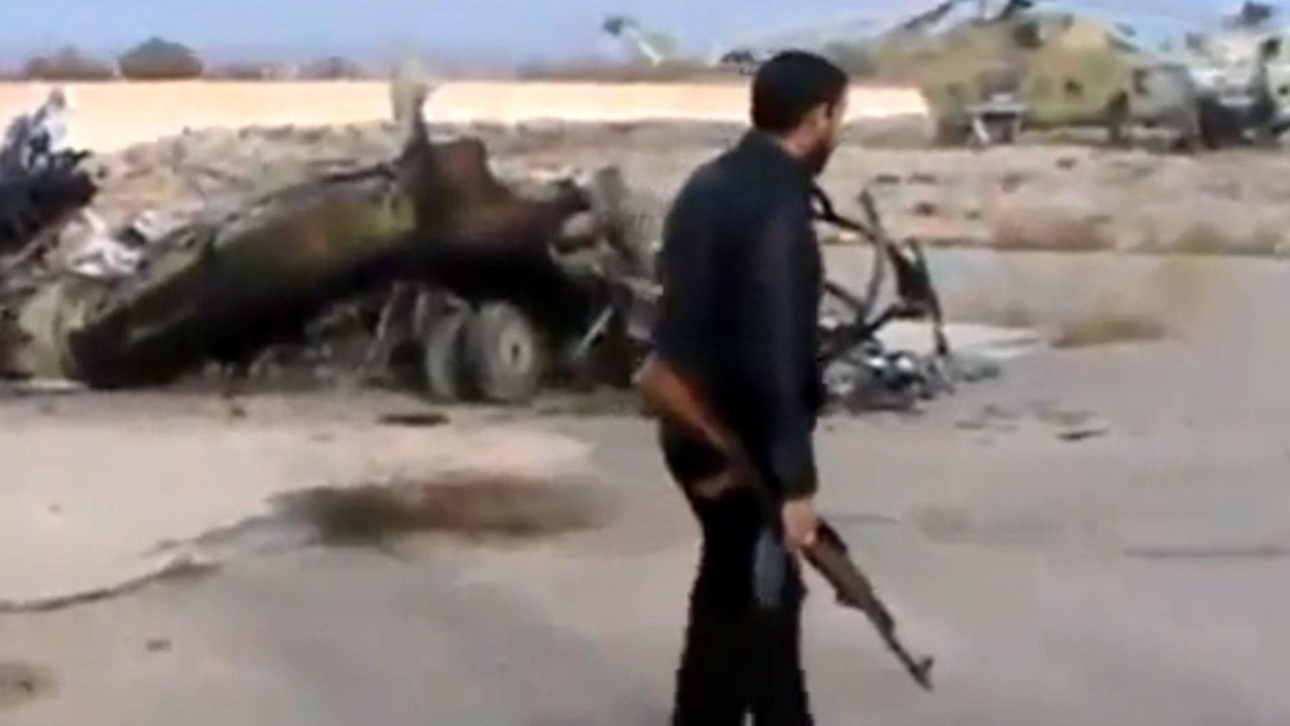 Nov. 25, 2012 -  Image taken from video obtained from Ugarit News of Syrian rebels capturing a helicopter air base near the capital Damascus after fierce fighting in Syria.