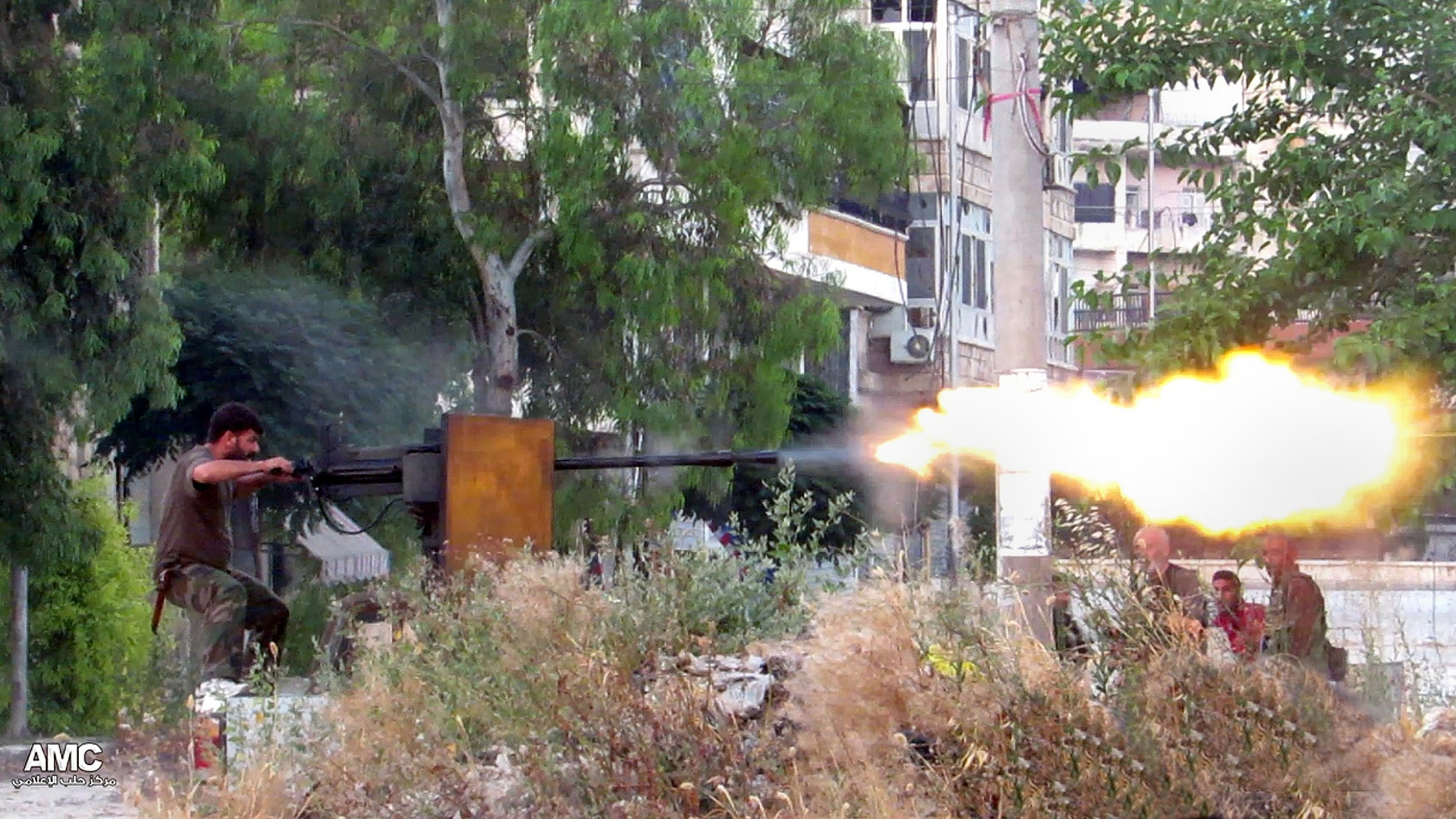 June 20, 2013 - A Syrian rebel firing a heavy machine gun towards Syrian soldiers loyal to Syrian president Bashar Assad, in Aleppo, Syria. (Citizen journalism image provided by Aleppo Media Center AMC.)