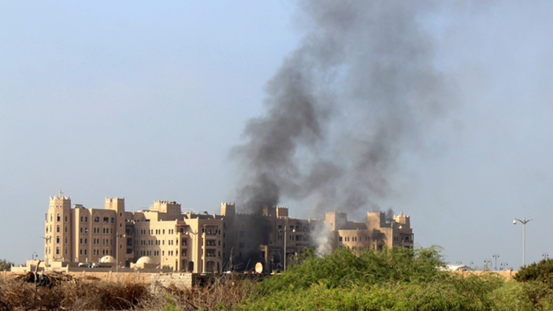 Oct. 6, 2015: Smoke rises following an explosion that hit Hotel al-Qasr where Cabinet members and other government officials are staying, in the southern port city of Aden, Yemen. Security officials, who work for Yemen's internationally recognized government said three explosions have hit Aden and there are casualties in Tuesday's explosions but they had no specifics or details. (AP Photo/Wael Qubady)