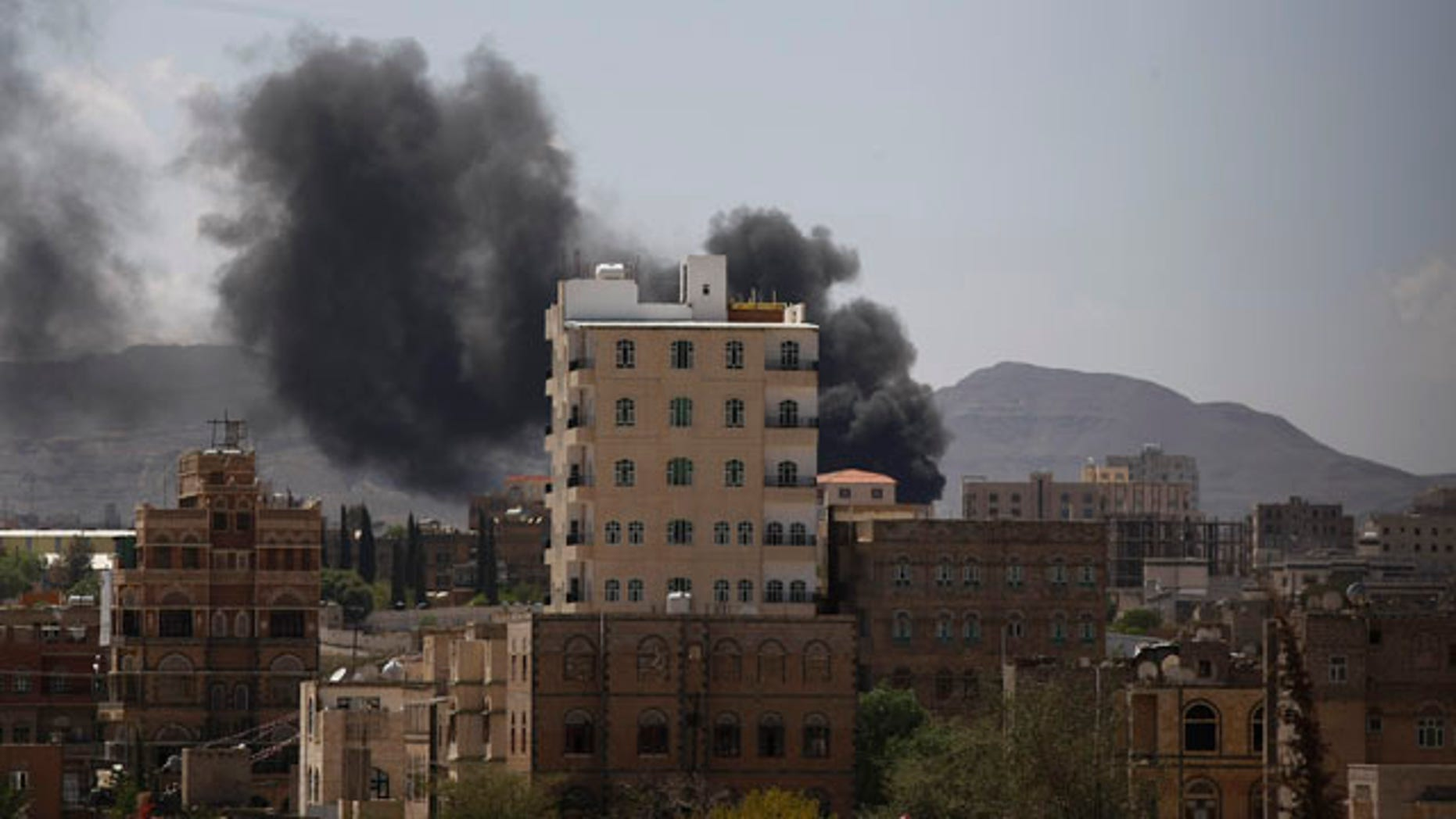 September 21, 2014: Smokes rises from an area during clashes between Sunni militiamen and Hawthi Shiite rebels in Sanaa, Yemen. (AP Photo/Hani Mohammed)