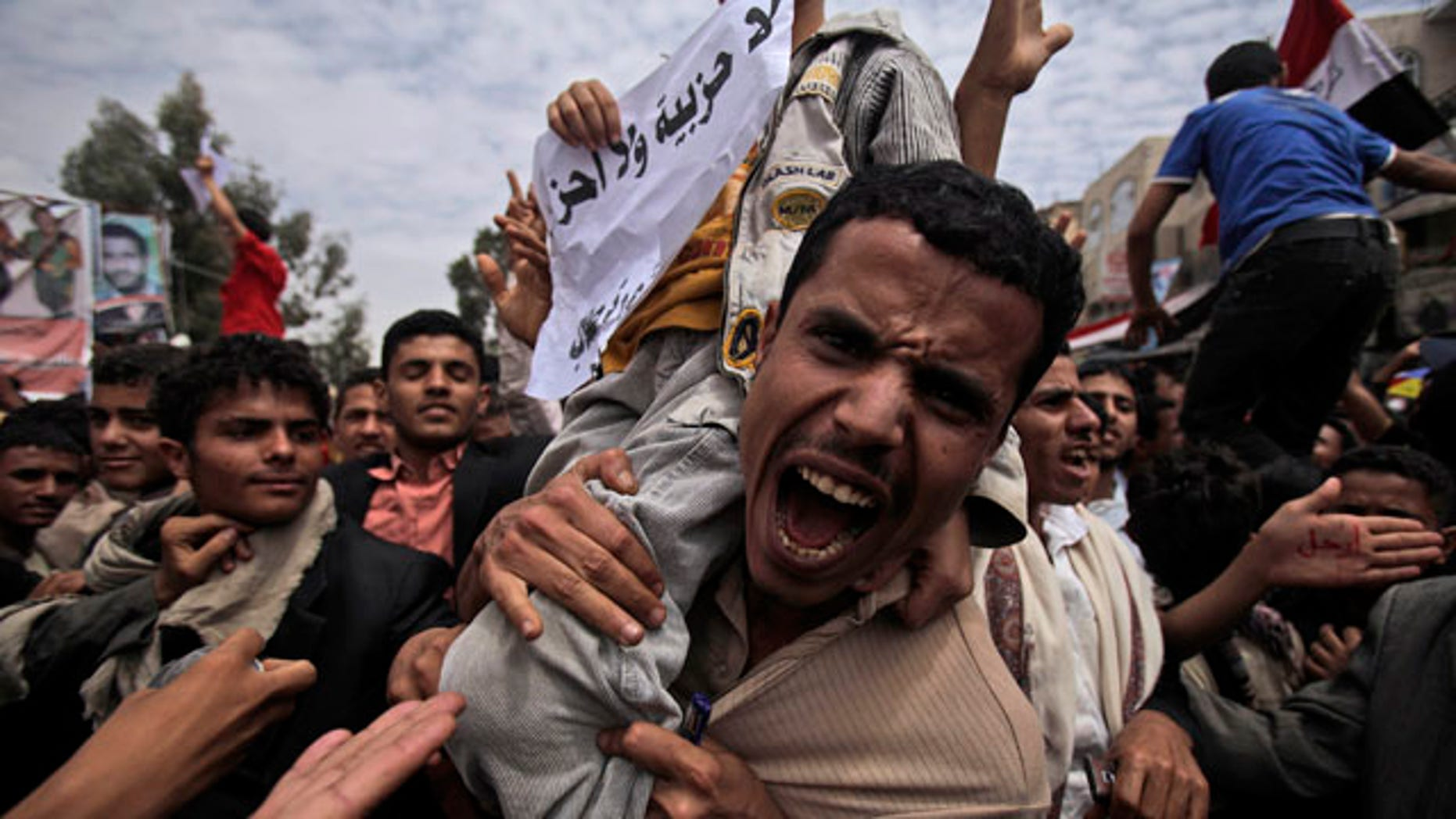 March 13, 2011: An anti-government protestor shouts during a demonstration demanding the resignation of Yemeni President Ali Abdullah Saleh, in Sanaa, Yemen.