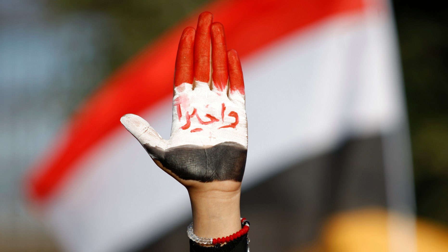 "Dec. 20, 2012 - Female protestor displays her hand painted with Yemen's flag  & Arabic reading ""finally!"" during a rally supporting president Abed Rabbu Mansour Hadi, in Sanaa, Yemen."
