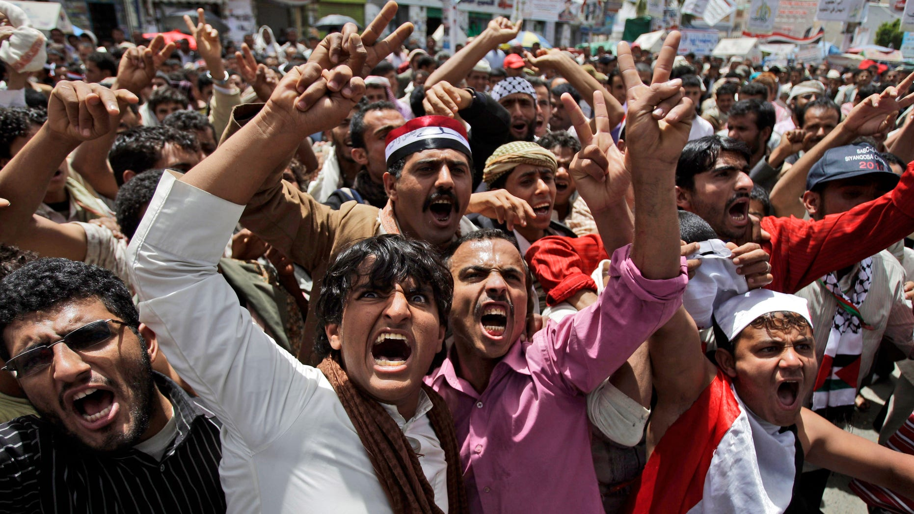 Anti-government protestors, shout slogans during a demonstration demanding the resignation of Yemeni President Ali Abdullah Saleh, in Sanaa, Yemen, Saturday, May 7, 2011.