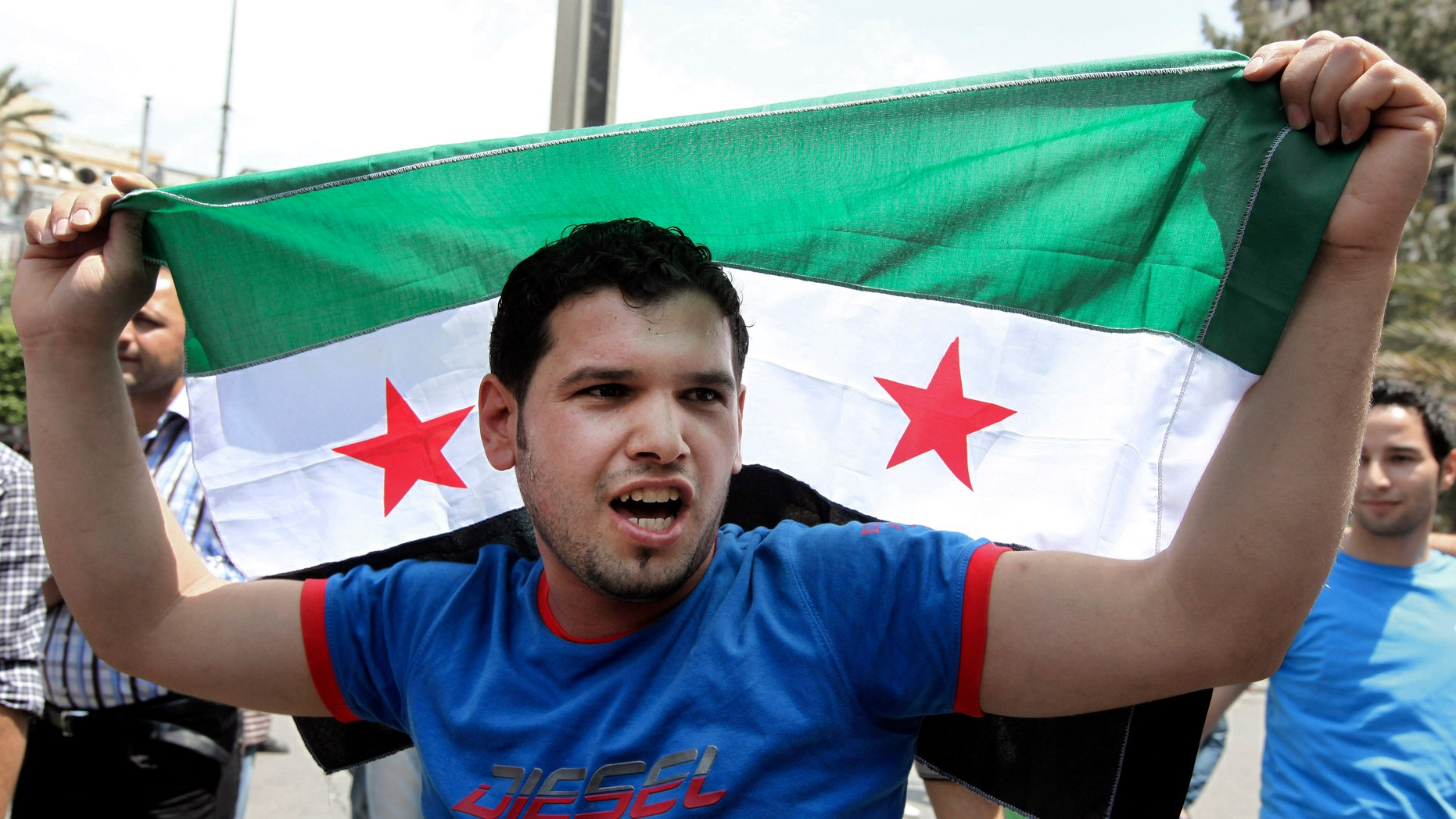 May 18, 2012: An anti-Syrian regime protester, chants slogans during a demonstration to show solidarity with the Syrian revolution in Beirut, Lebanon.