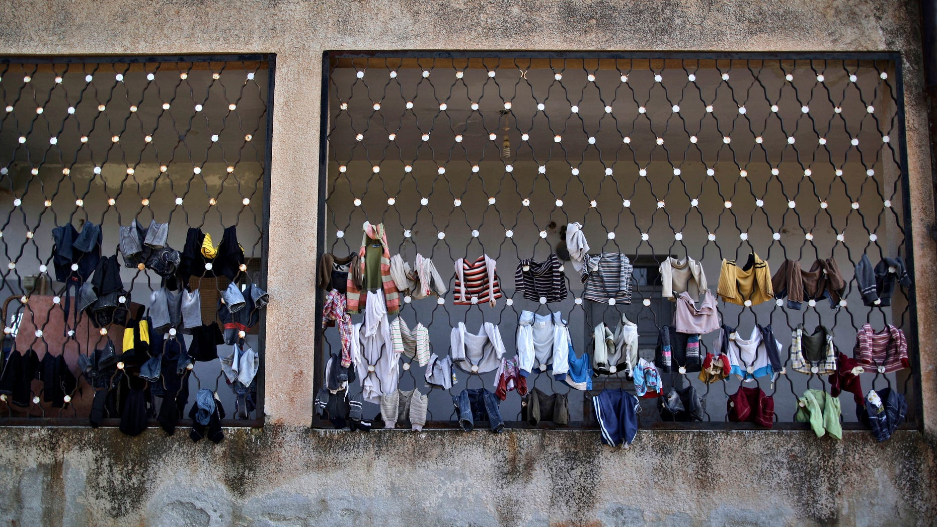 Dec. 14, 2012: Laundry belongs to Syrian children who fled their homes with their families due government airstrikes, are hung on a school where they are taking refuge, in Maaret Misreen, near Idlib, Syria.
