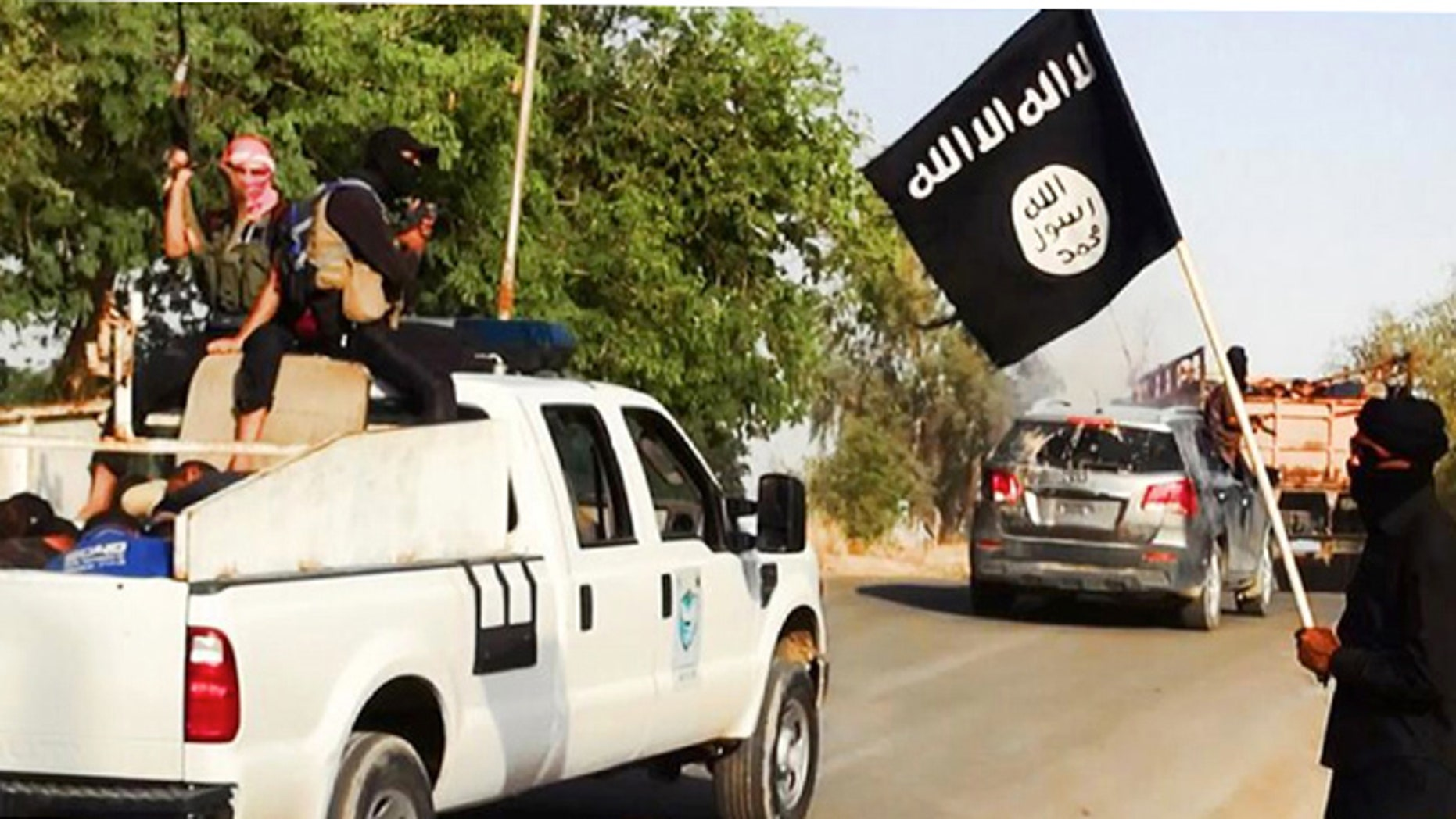 June 14, 2014: Image on a militant website that appears to show militants from Islamic State of Iraq and the Levant near Tikrit, Iraq.