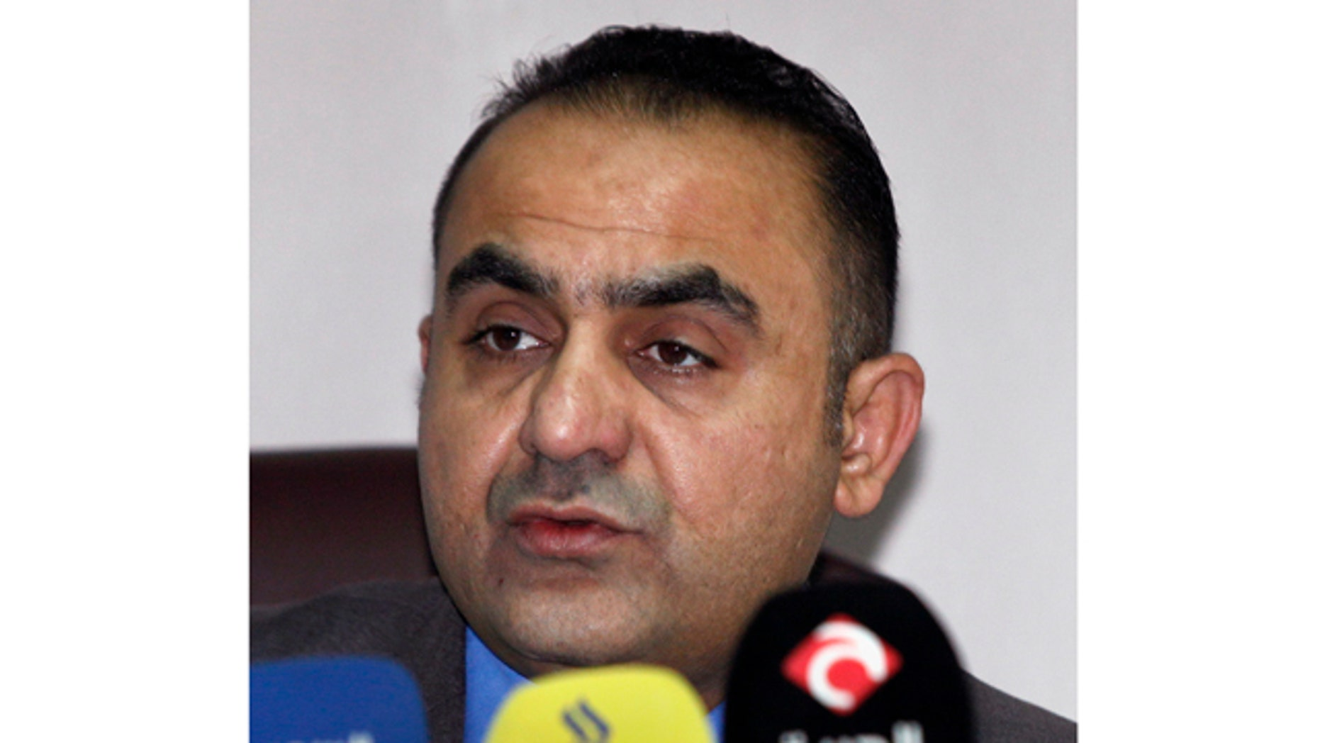Feb. 16, 2012- Abdul-Sattar Bayrkdar, Iraqi Supreme Judicial Council spokesman, speaks to reporters in Baghdad, Iraq. An Iraqi investigation panel says the country's Sunni vice president and his employees were behind years of deadly attacks on security officials and Shiite pilgrims.