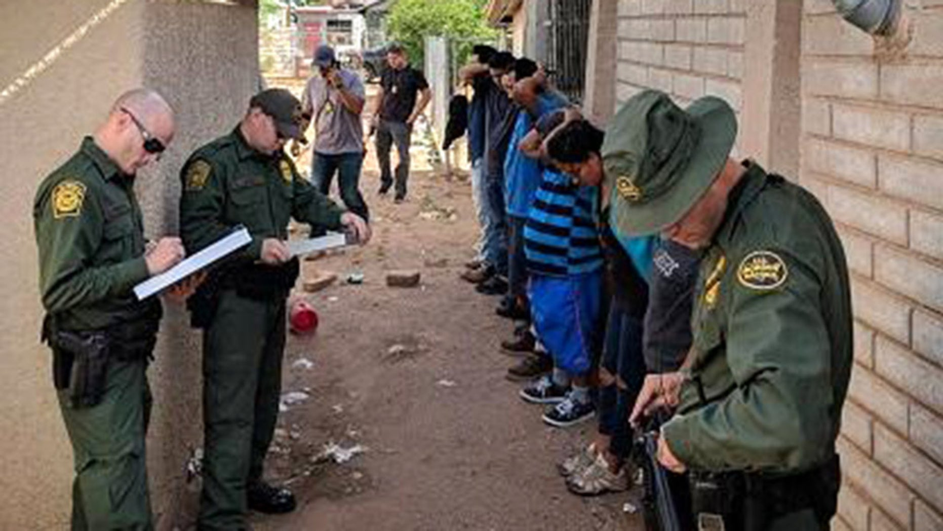 Border patrol agents swooped on the home in Douglas, Arizona, after observing several vehicles dropping people off through the day on Tuesday.